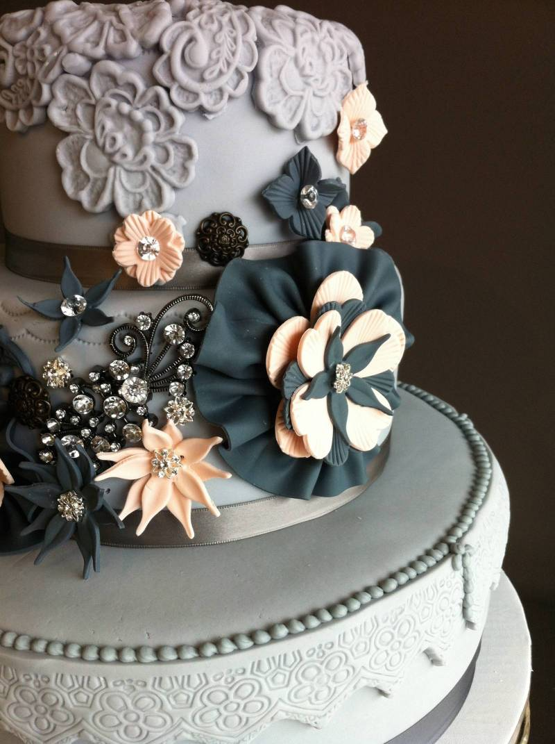 Vintage wedding cakes canmore wedding cake we are absolutely in love with this vintage grey wedding cake encrusted with jewels and accented with bold black and peach flowers junglespirit Images
