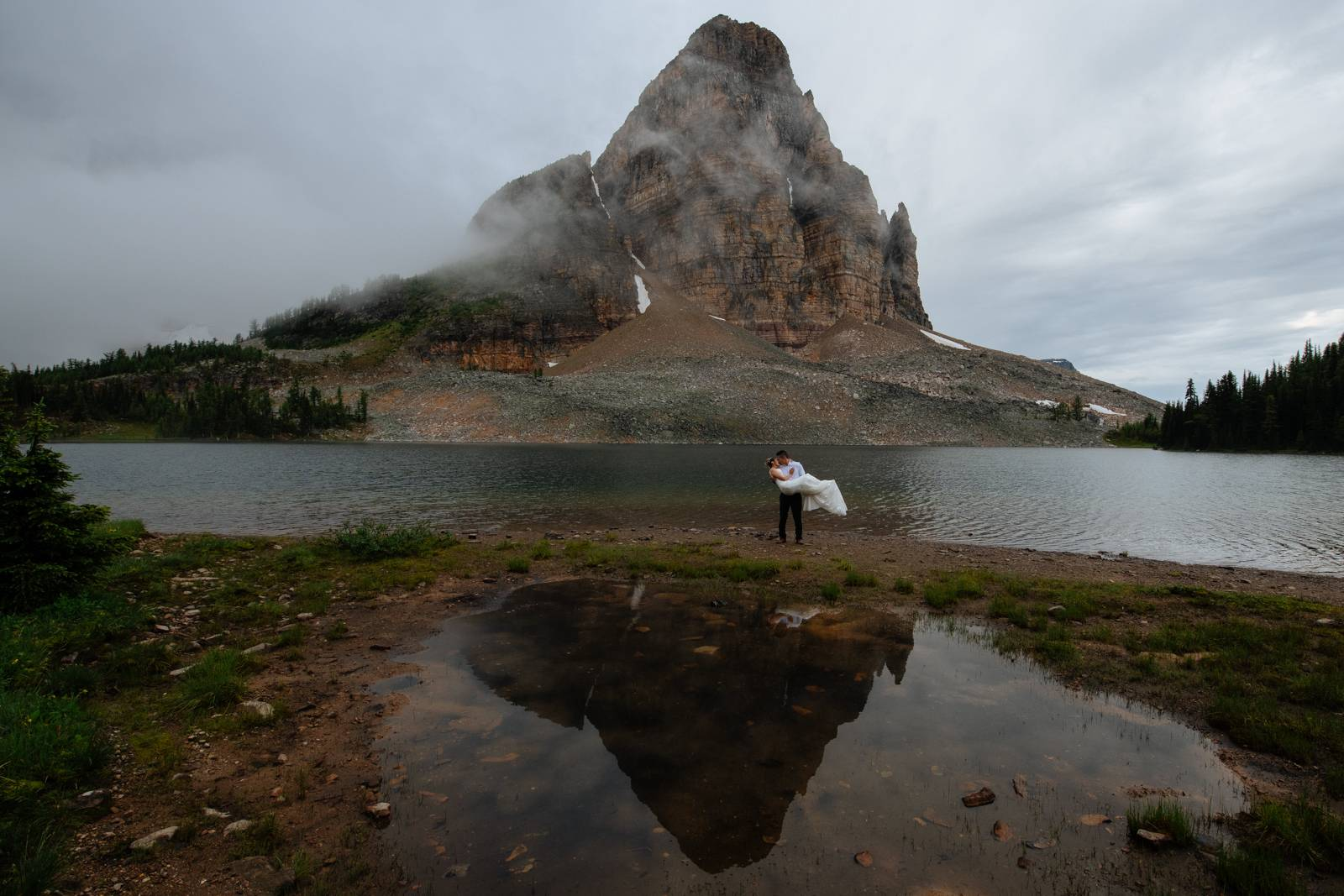 wedding couple by mountain reflection