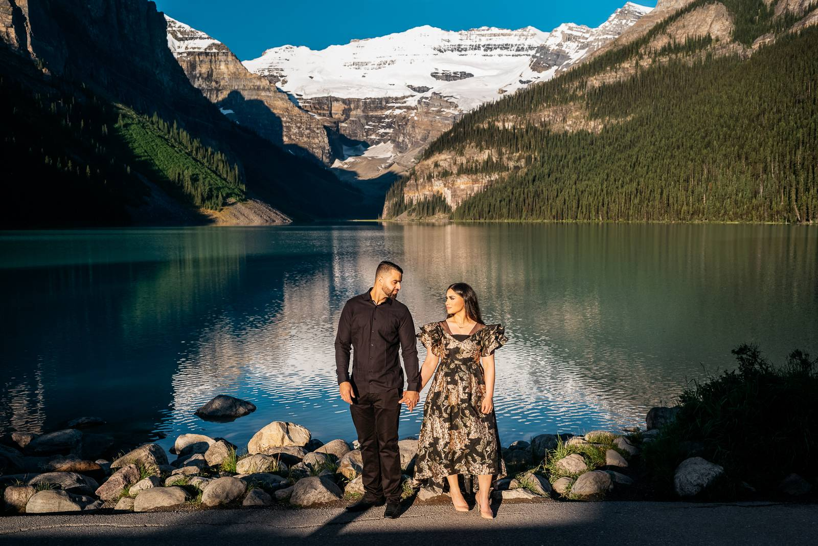 Lake Louise engagement couple holding hands