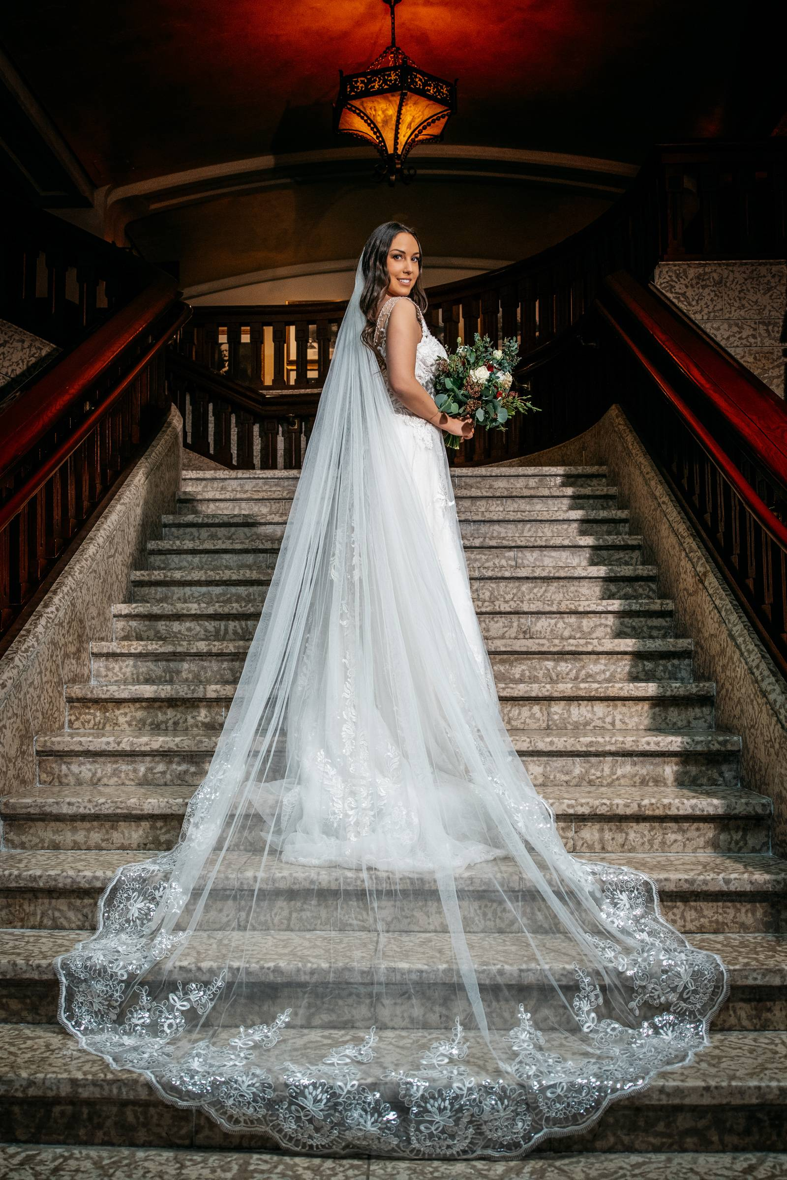 bride-standing on the stairs at Banff Springs hotel
