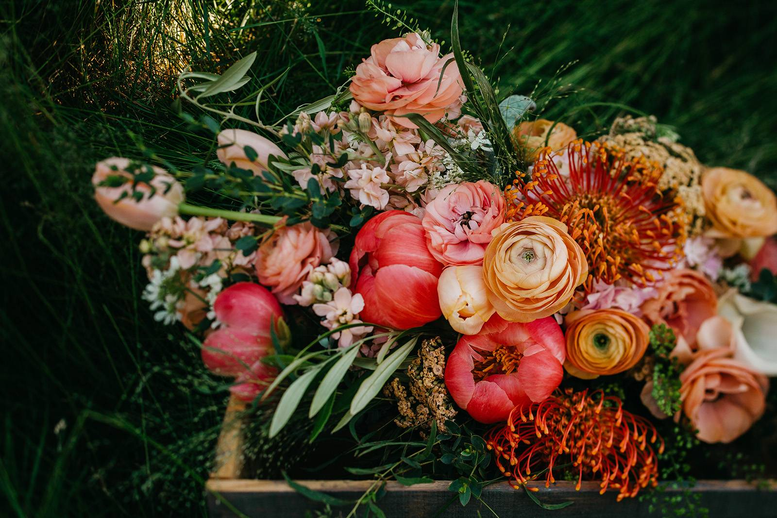 bold bright peach pink orange bridal wedding bouquet flowers floral blooms wisconsin florist madison