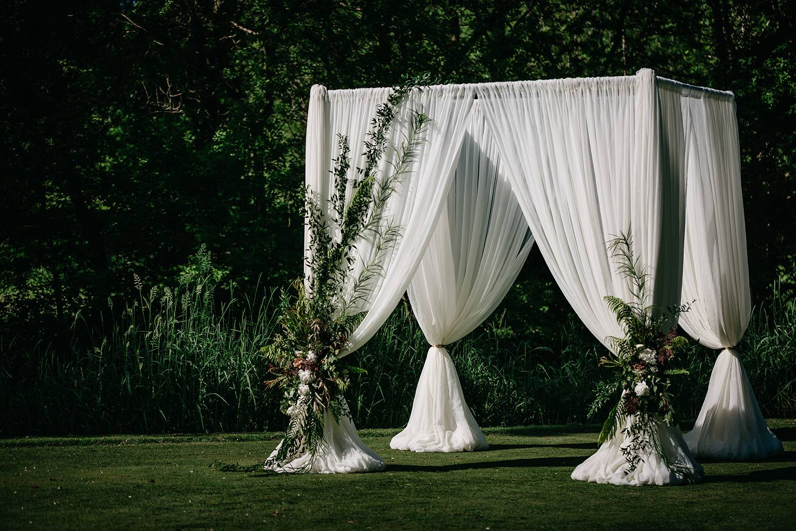 ceremony arch arbor canopy floral installation wedding decor white draping