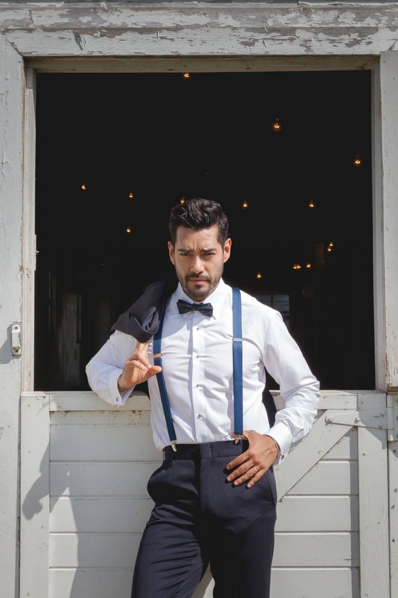 groom, groom tux, groom suit, groom style guide suspenders bow tie, navy tux, navy suit