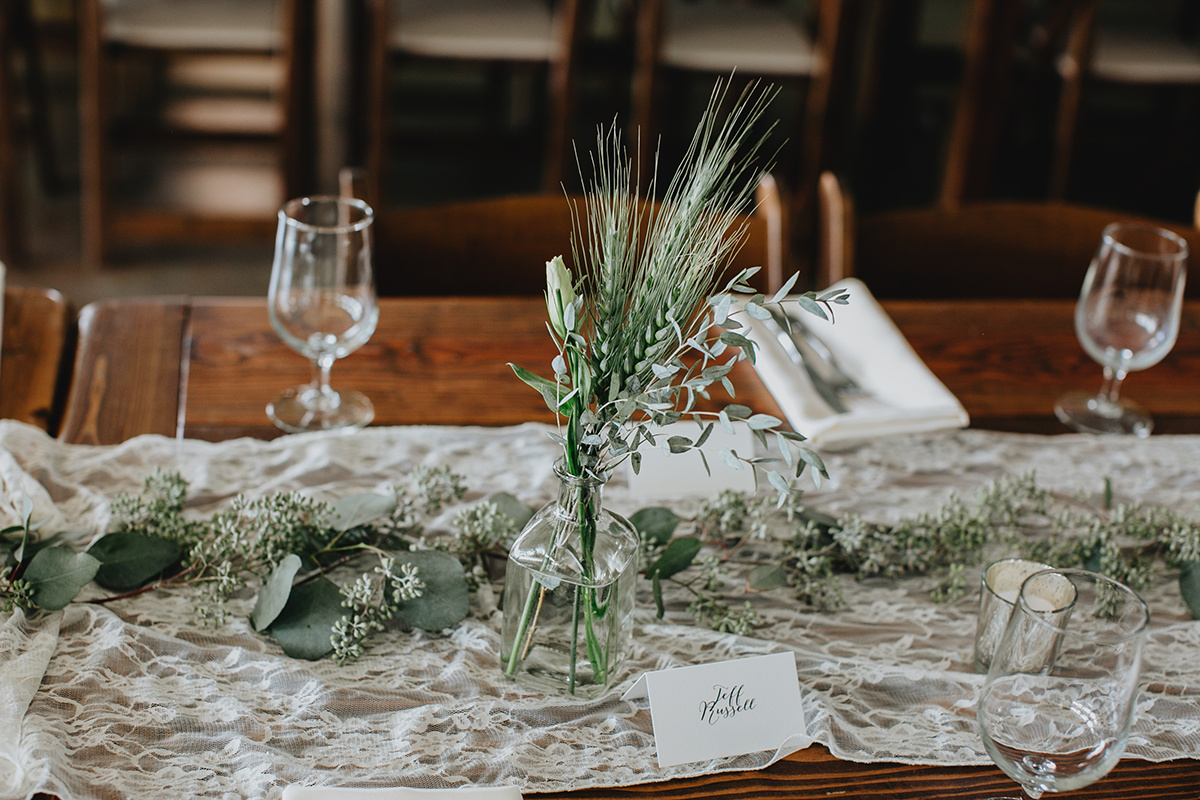 greenery centerpieces, lace table runner