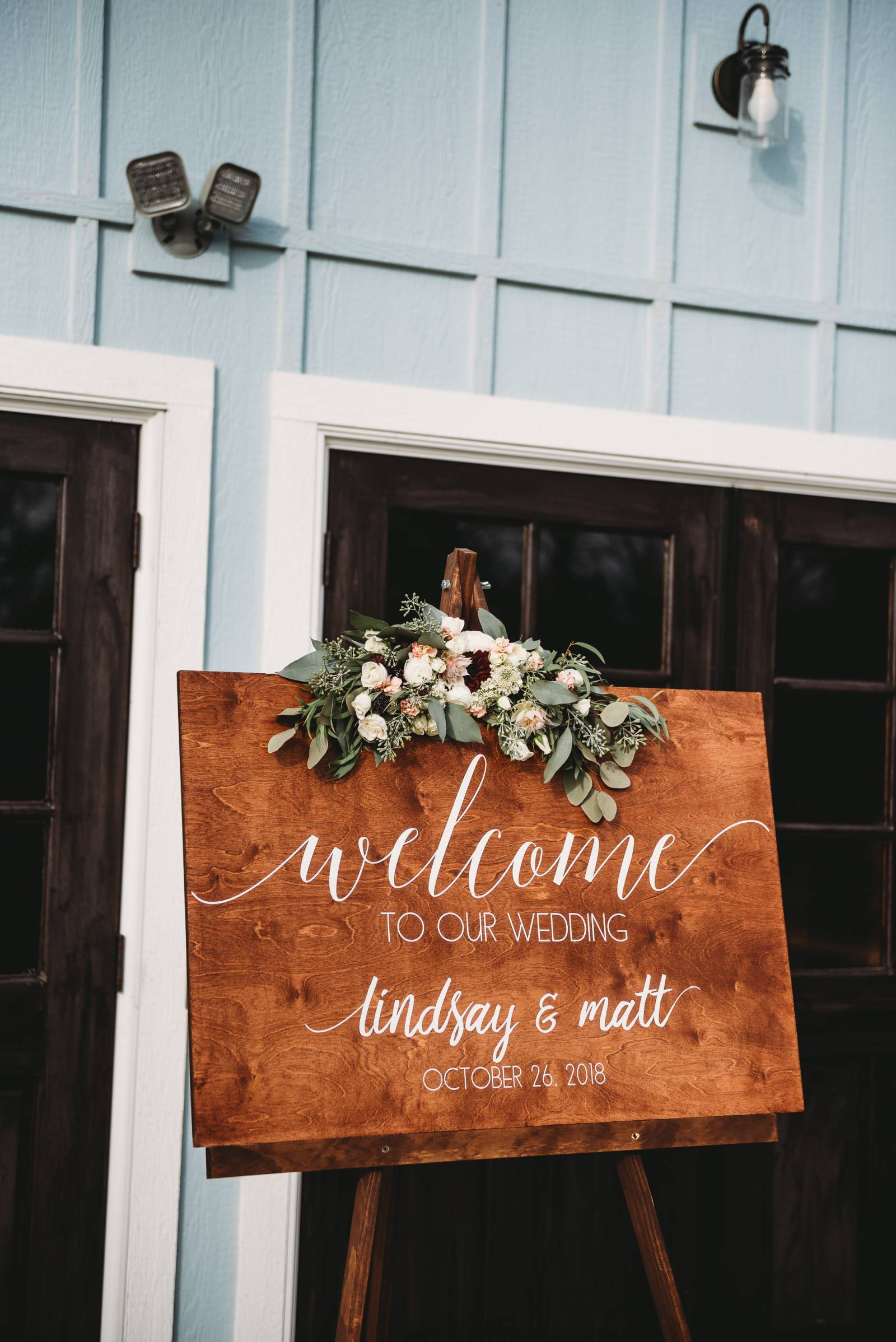 calligraphy wood welcome wedding sign florals