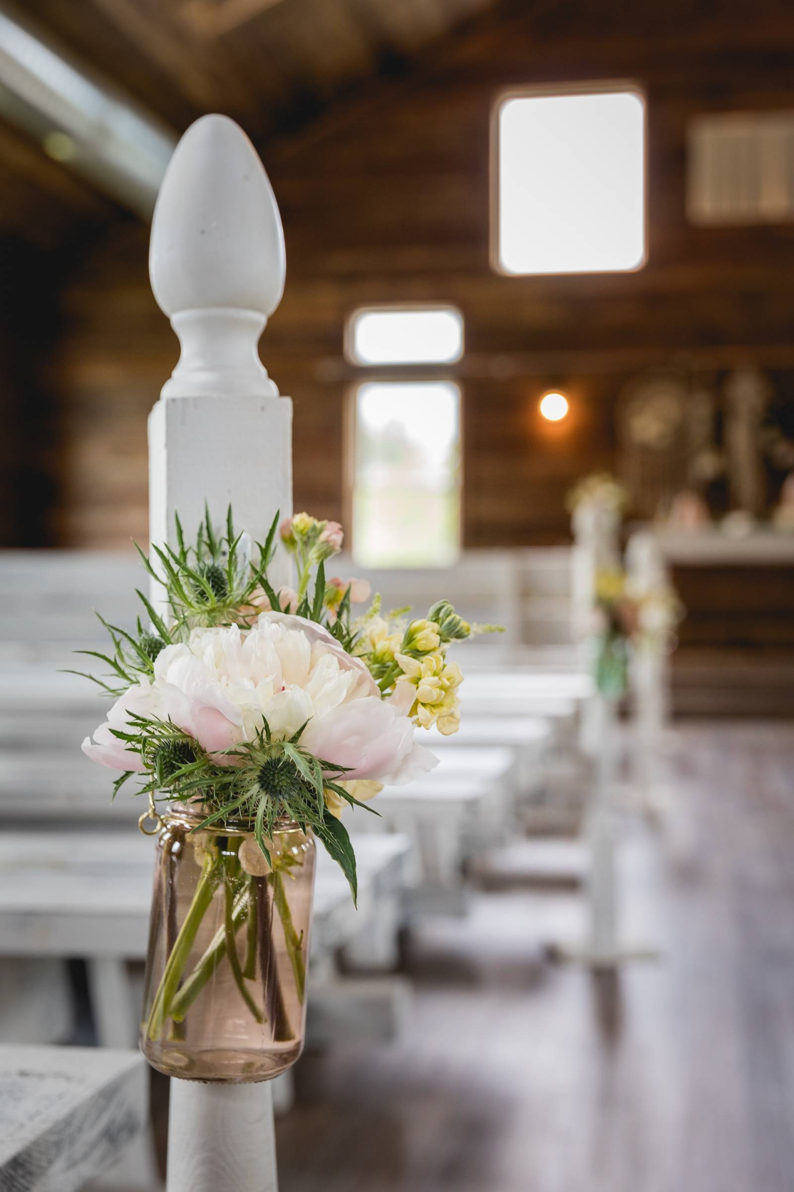 barn wedding ceremony pew chair side floral