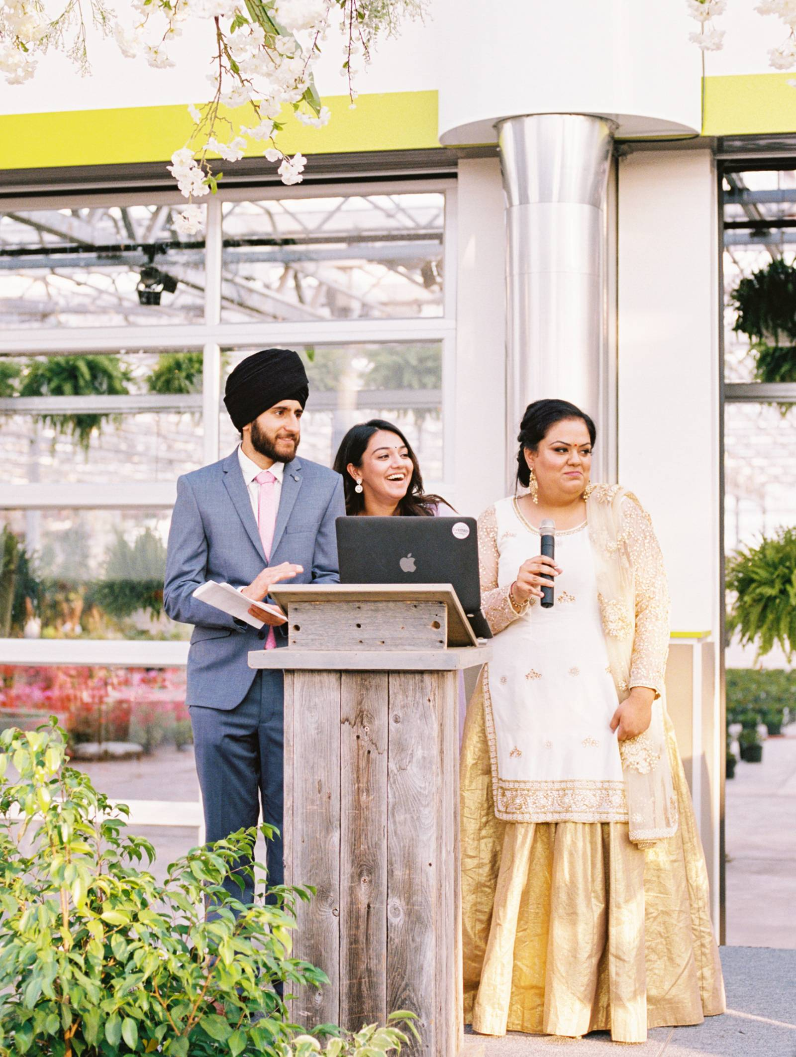 Friends of the bride and groom make a speech at the reception at the St Albert Enjoy Center