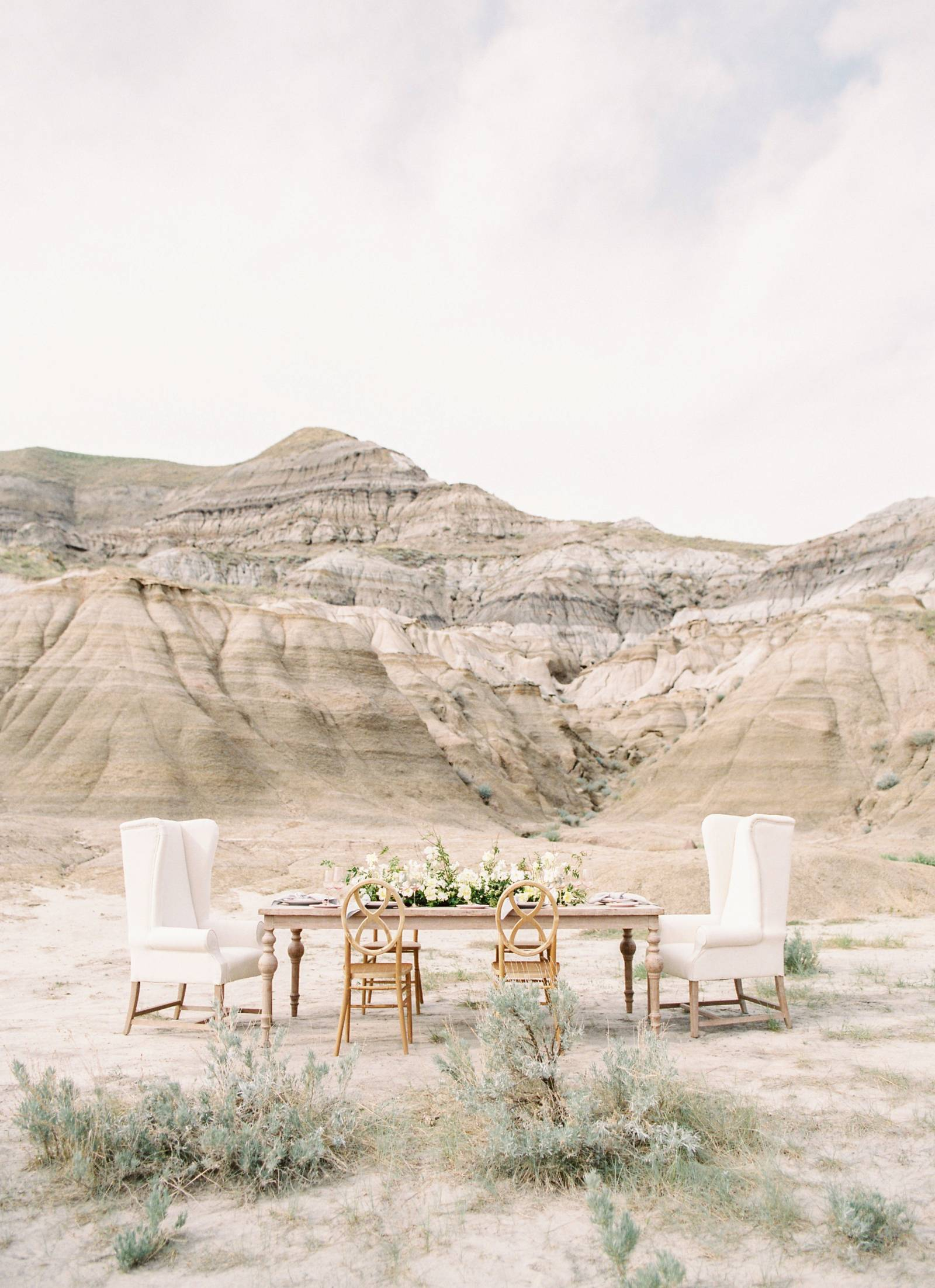 a romantic styled wedding reception table set up in the Drumheller desert