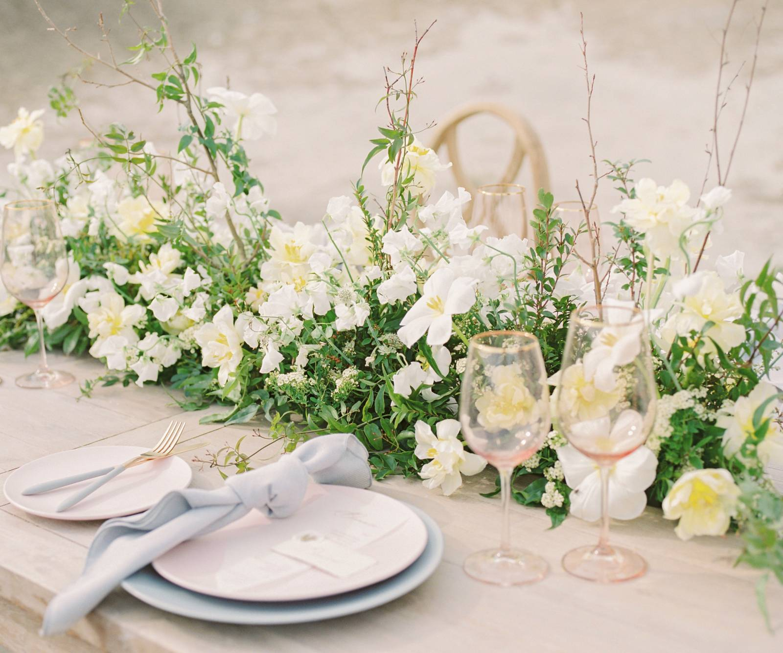a soft and romantic table set up for an outdoor Drumheller wedding reception