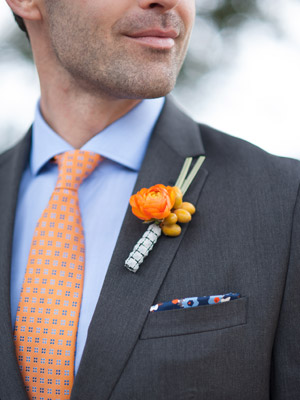 gray suit orange tie and boutonniere