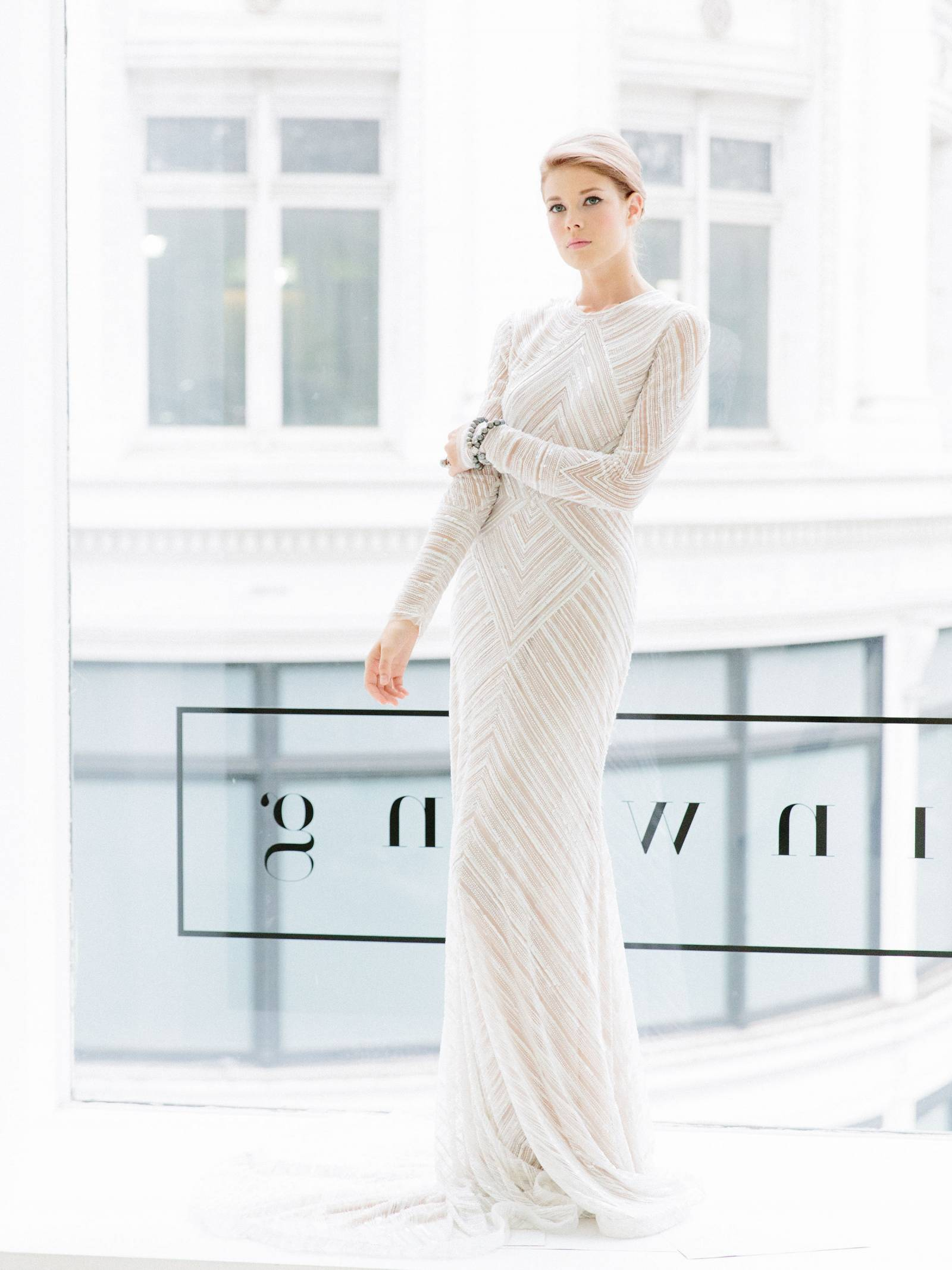 Sexy high necked, long sleeved Naeem Kahn wedding gown from Jinwang