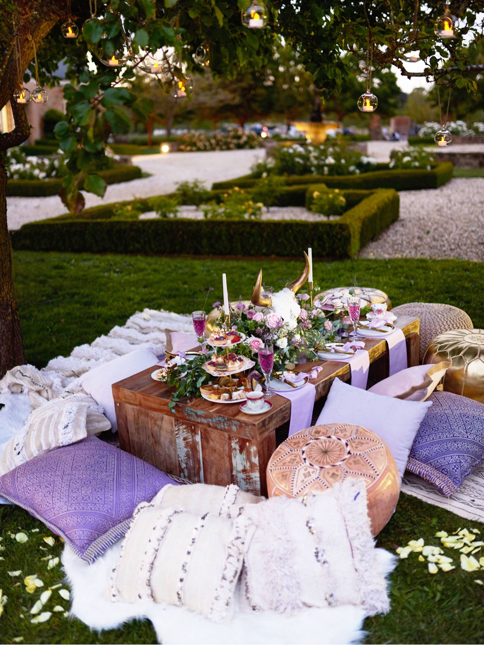 Rustic wood table with pink and lavender florals, dessert tower, china and pillows