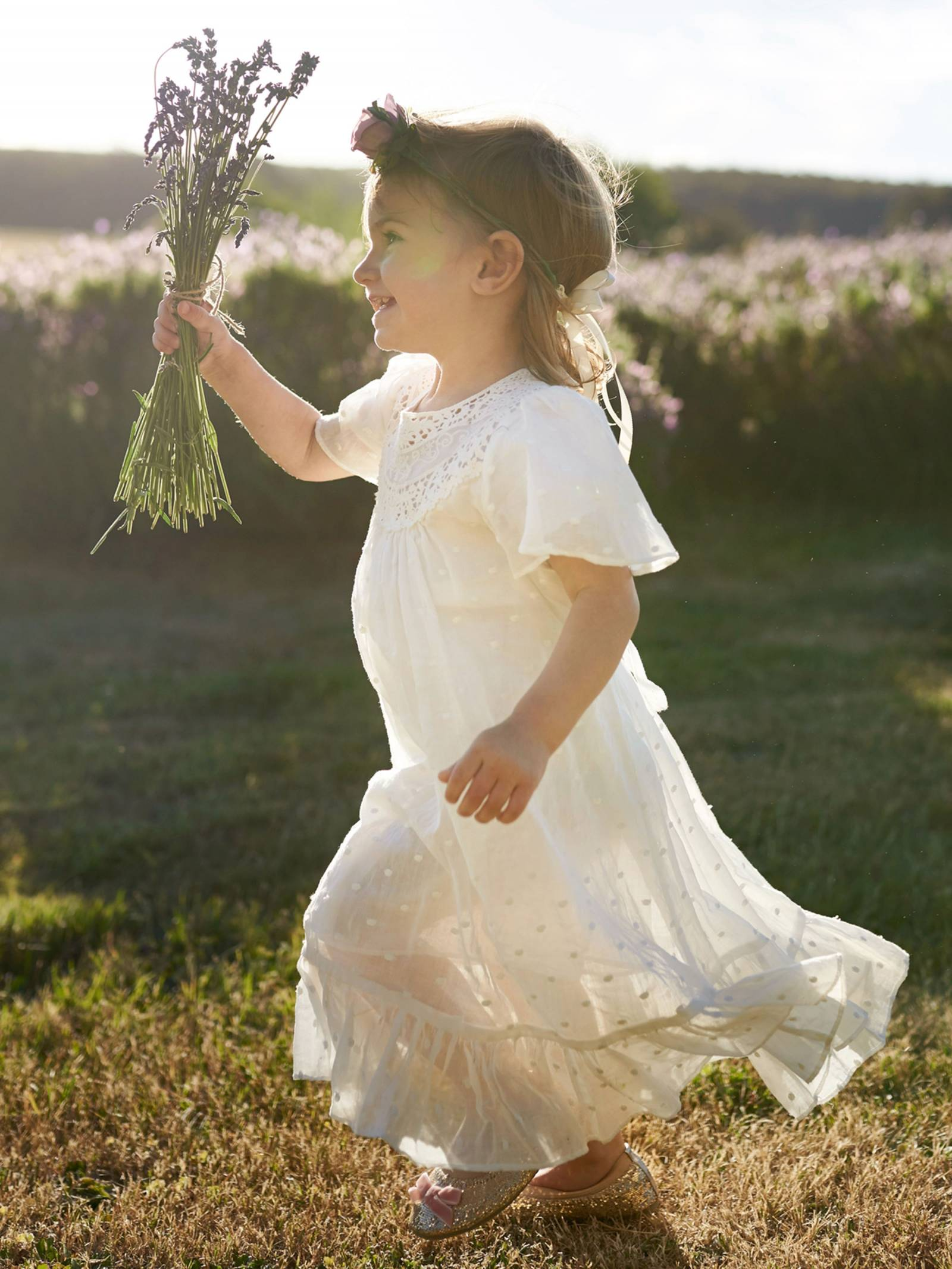 Flower girl running through a lavender field