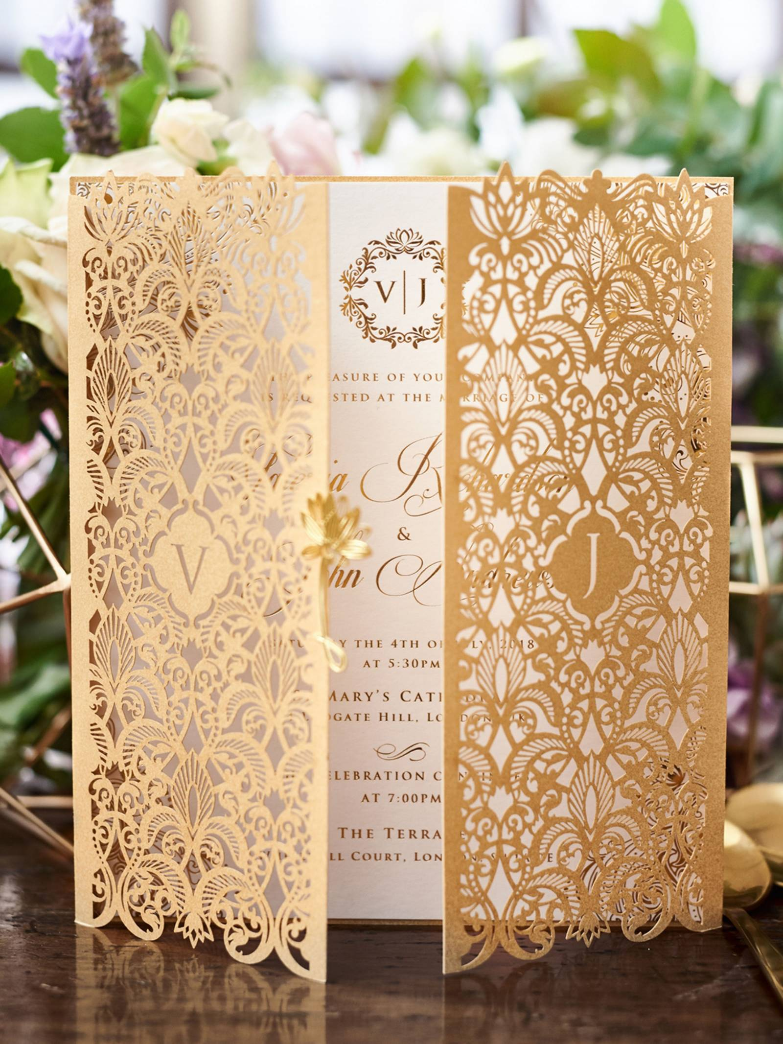Ornate gold and white wedding invitation