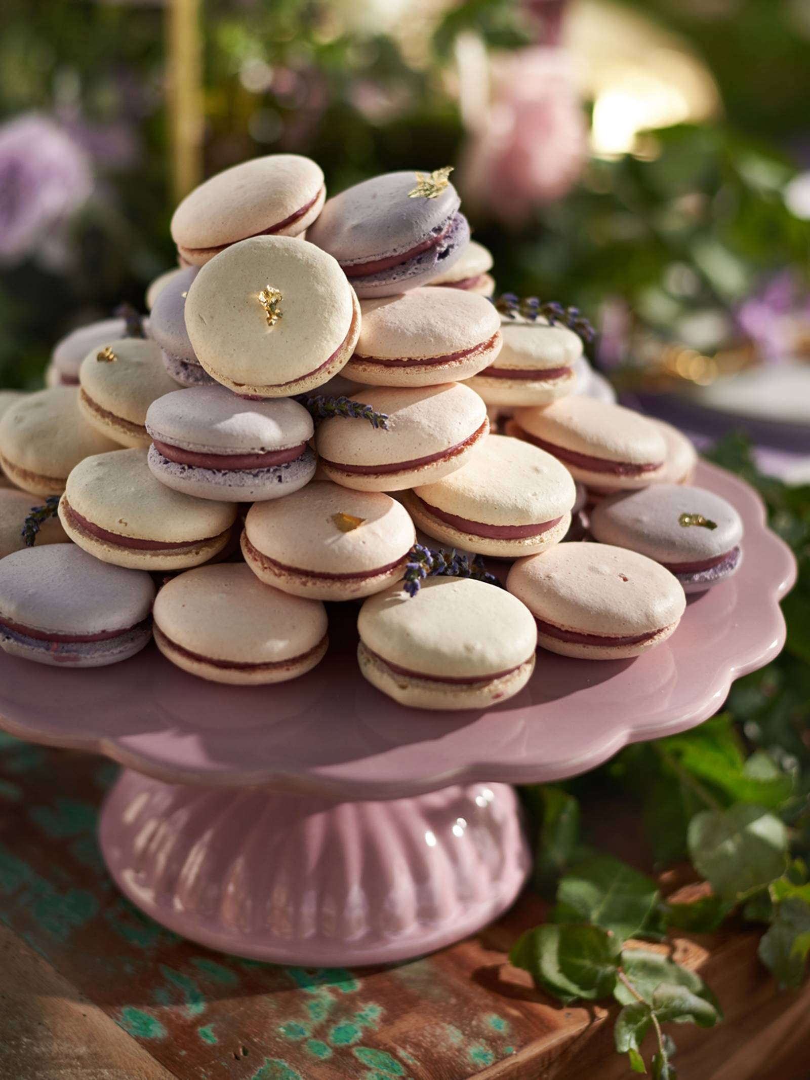 Ivory and lavender macarons on a mauve cake stand