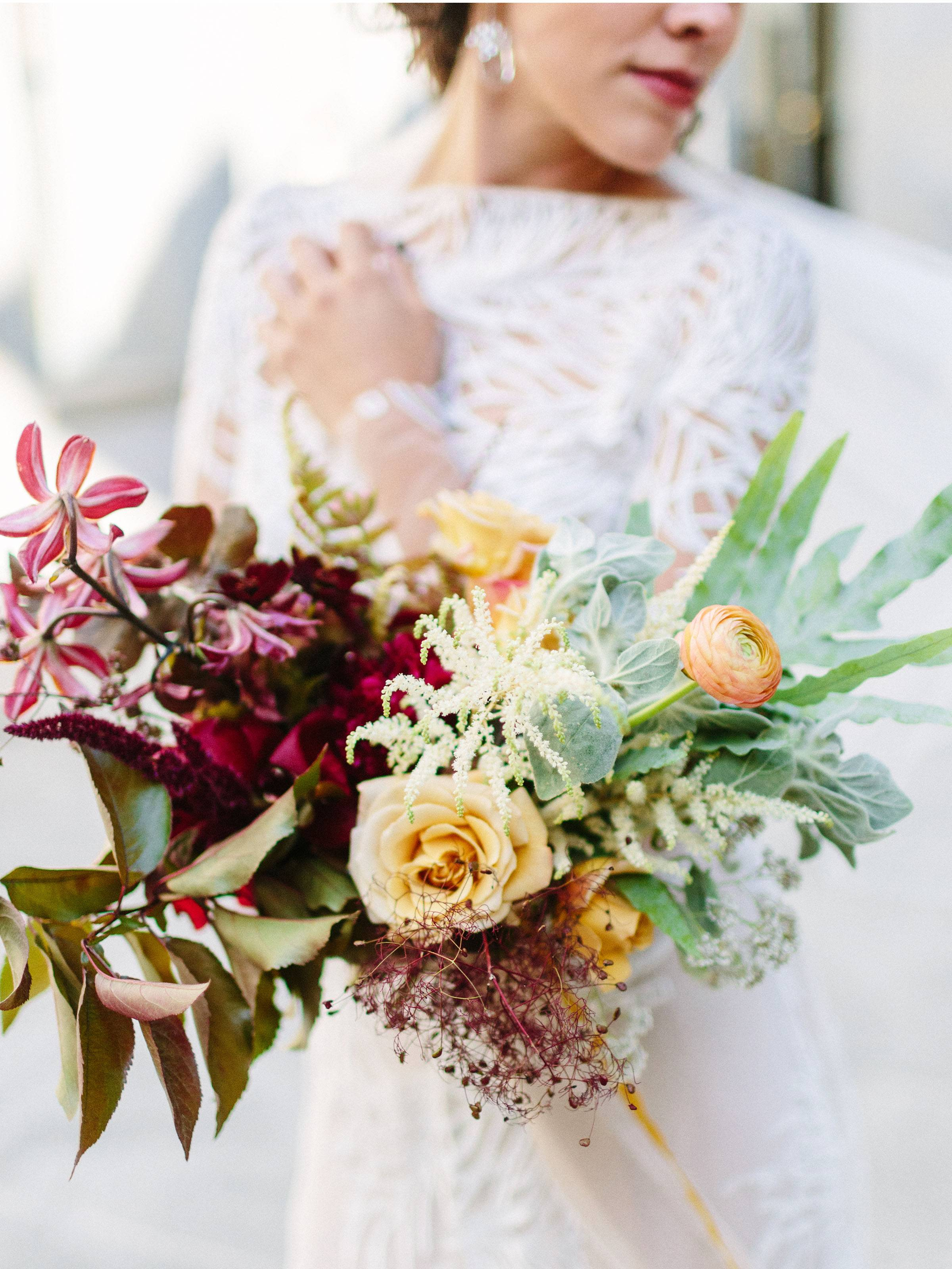 Multi-color bouquet with burgundy, yellow and mint green flowers