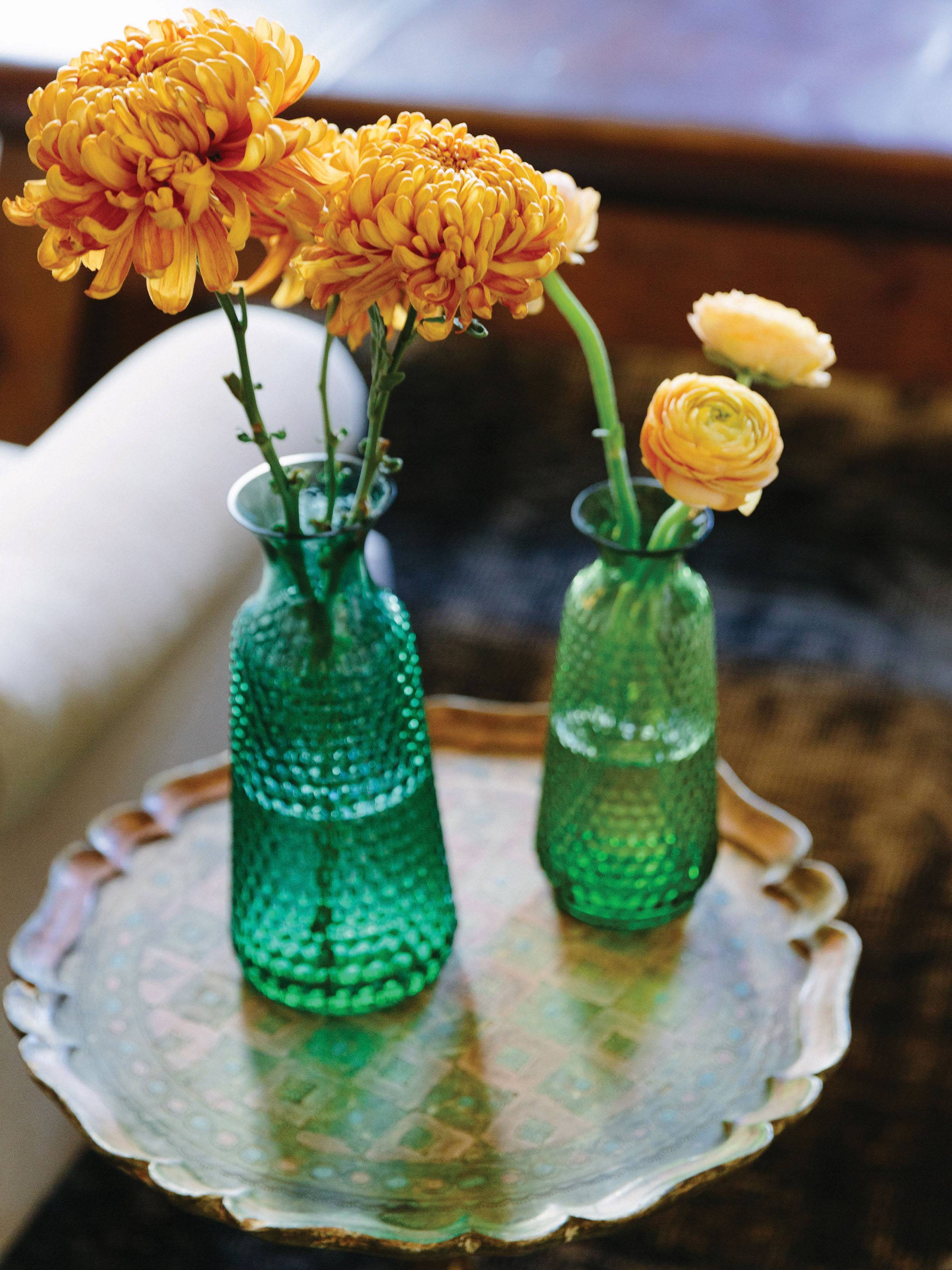 Vintage emerald green vases with orange and yellow flowers