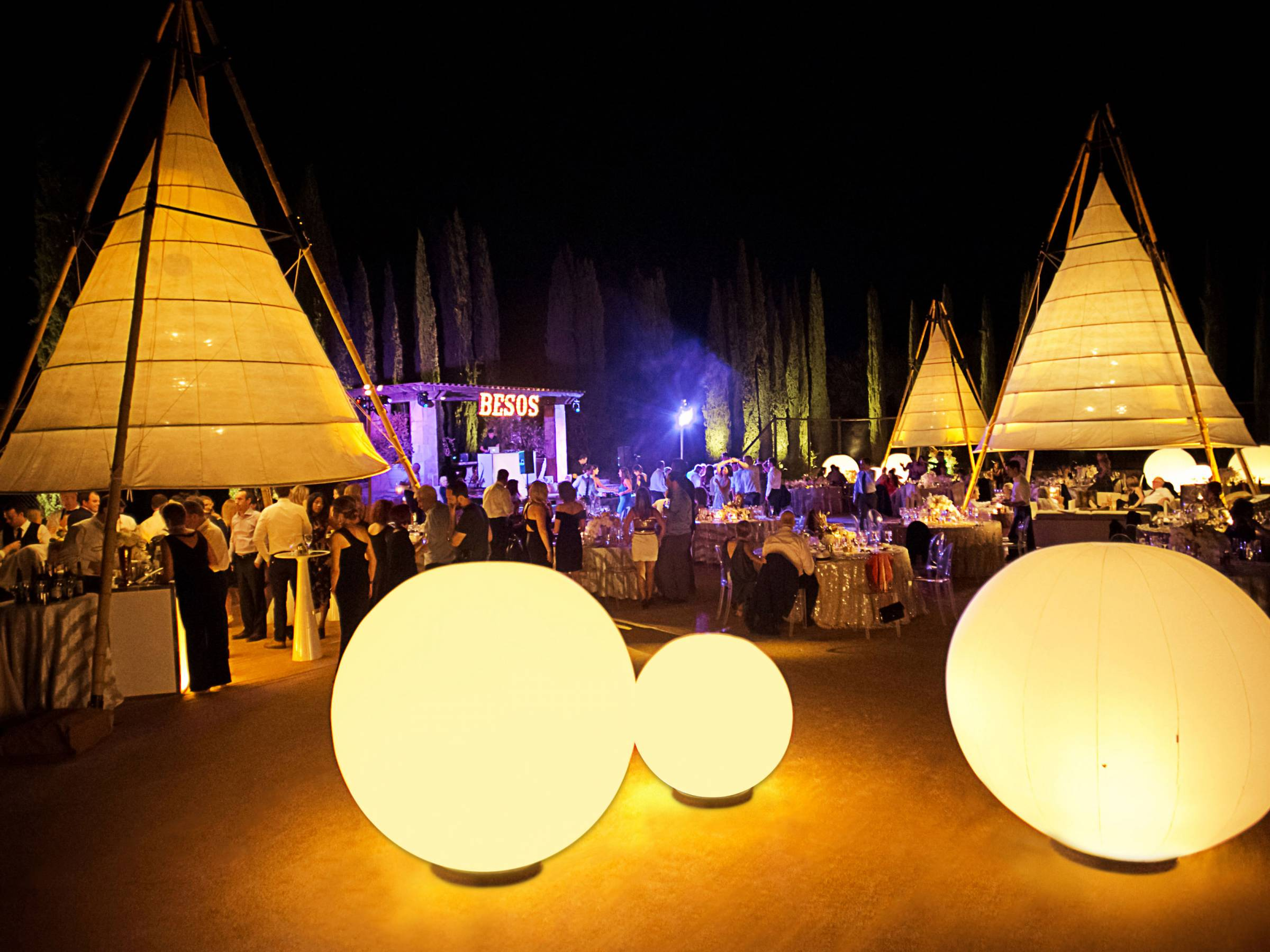 Glowing giant tepees and large glowing spheres