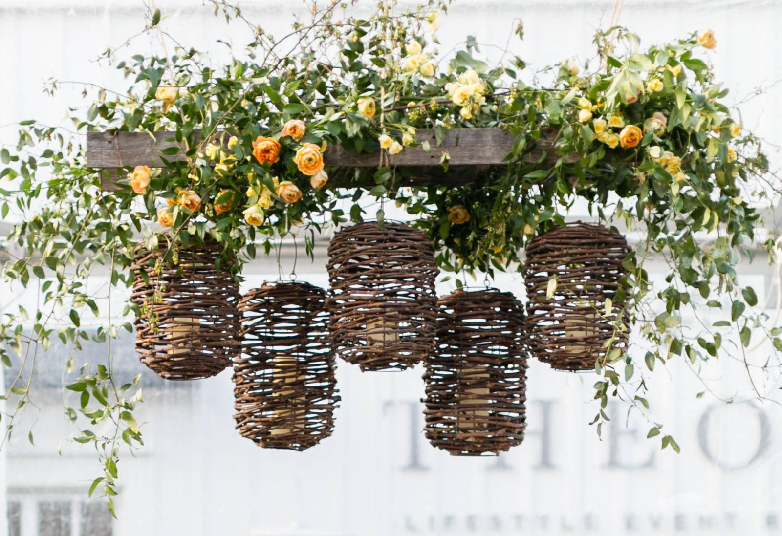 Hanging florals and wicker lanterns