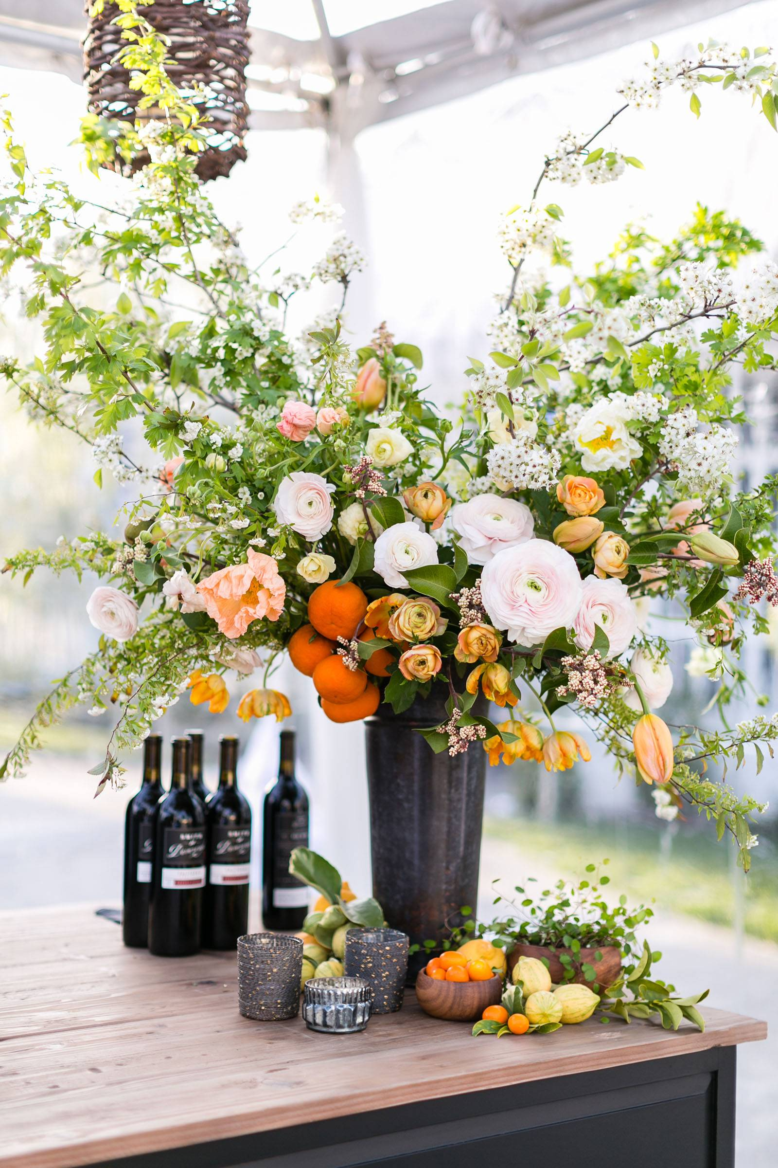 Large floral arrangement in white, peach and orange tones