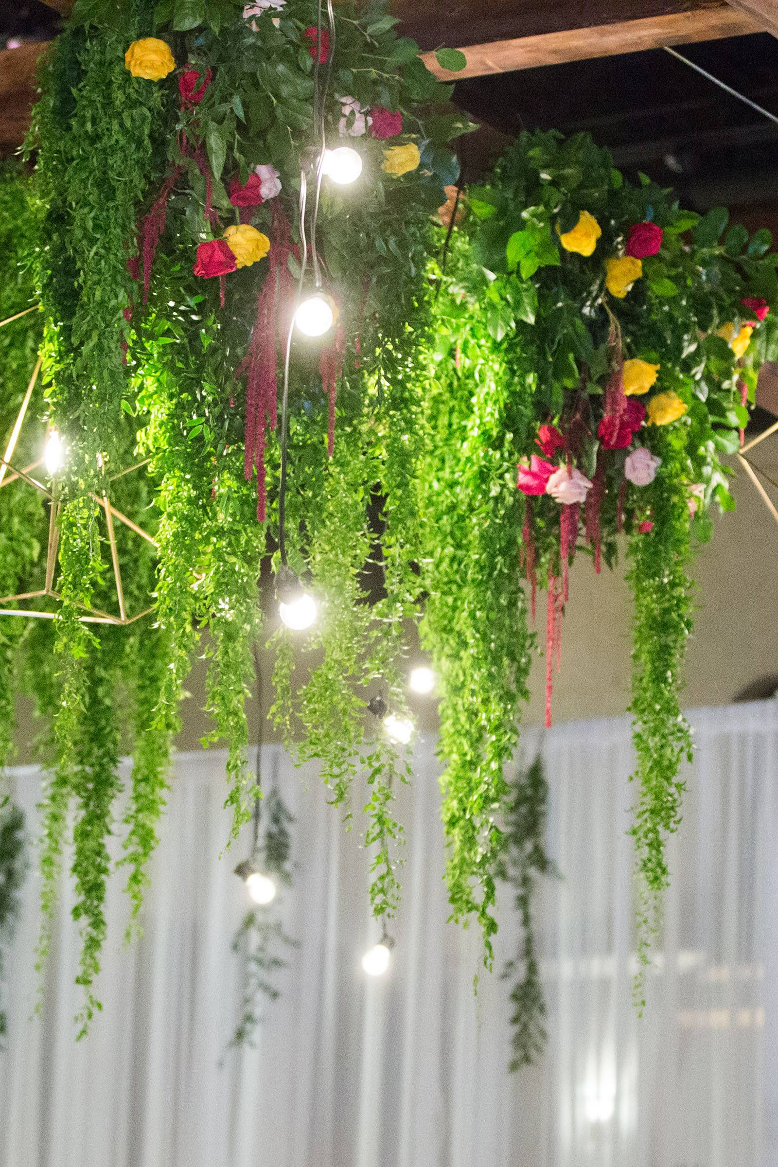 Hanging florals and bistro lights