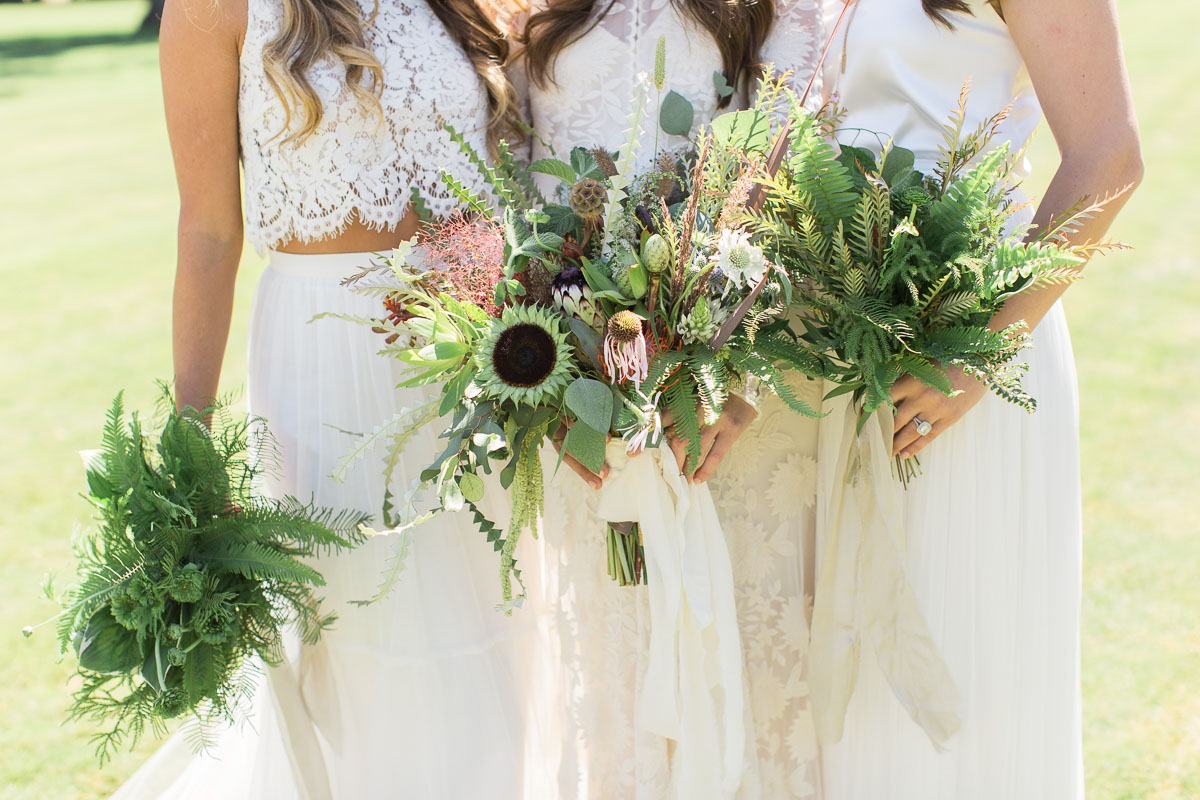 bridesmaids and bouquets of greenery