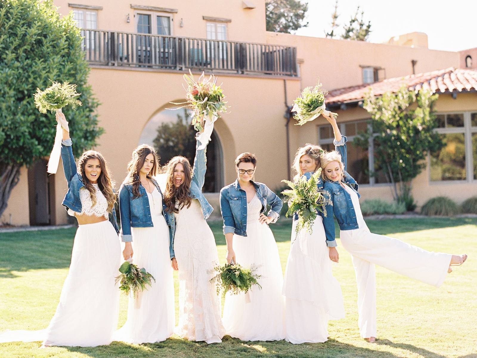 bridesmaids in white dresses and denim jackets