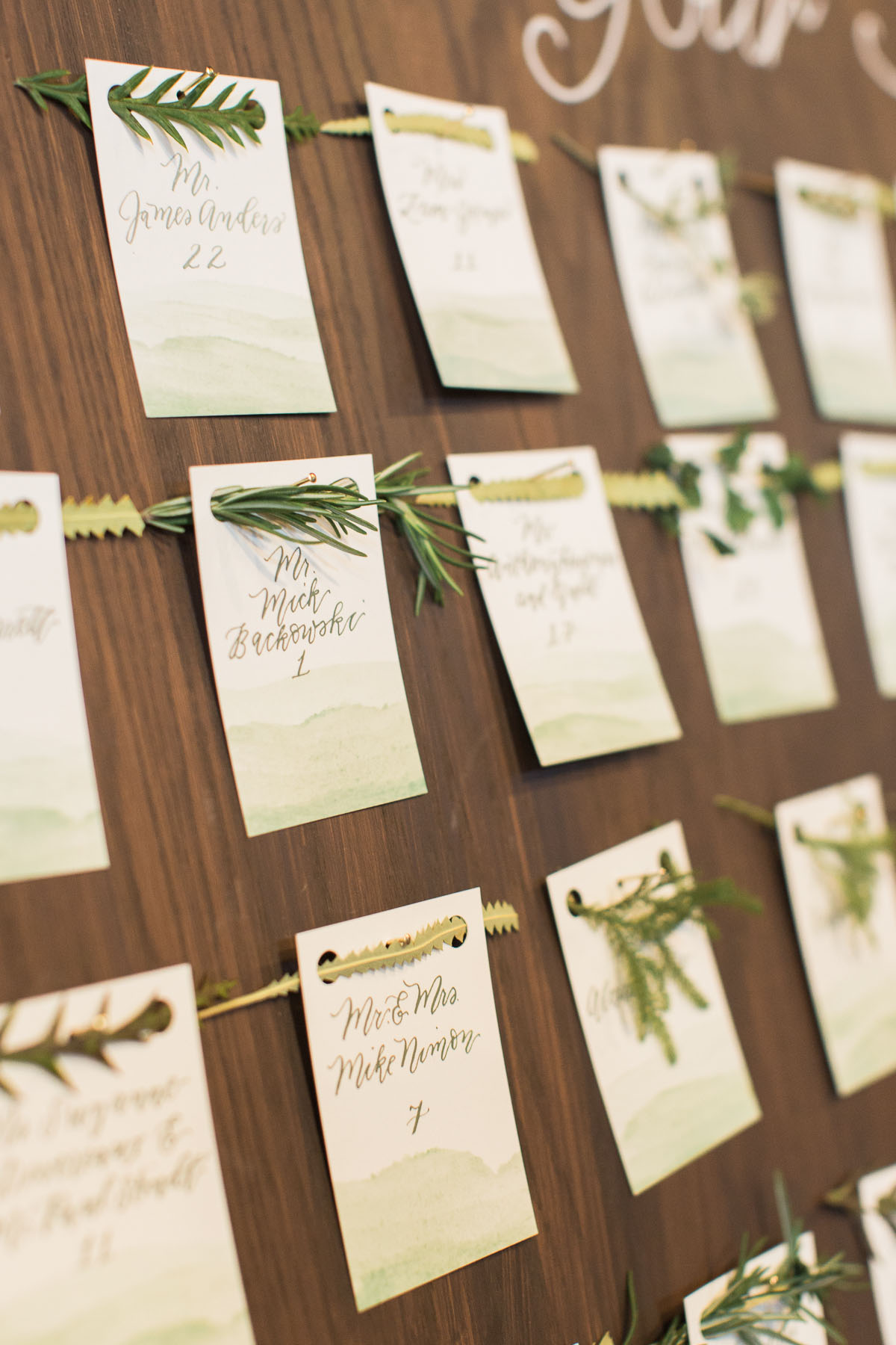 place card display with herbs and greenery