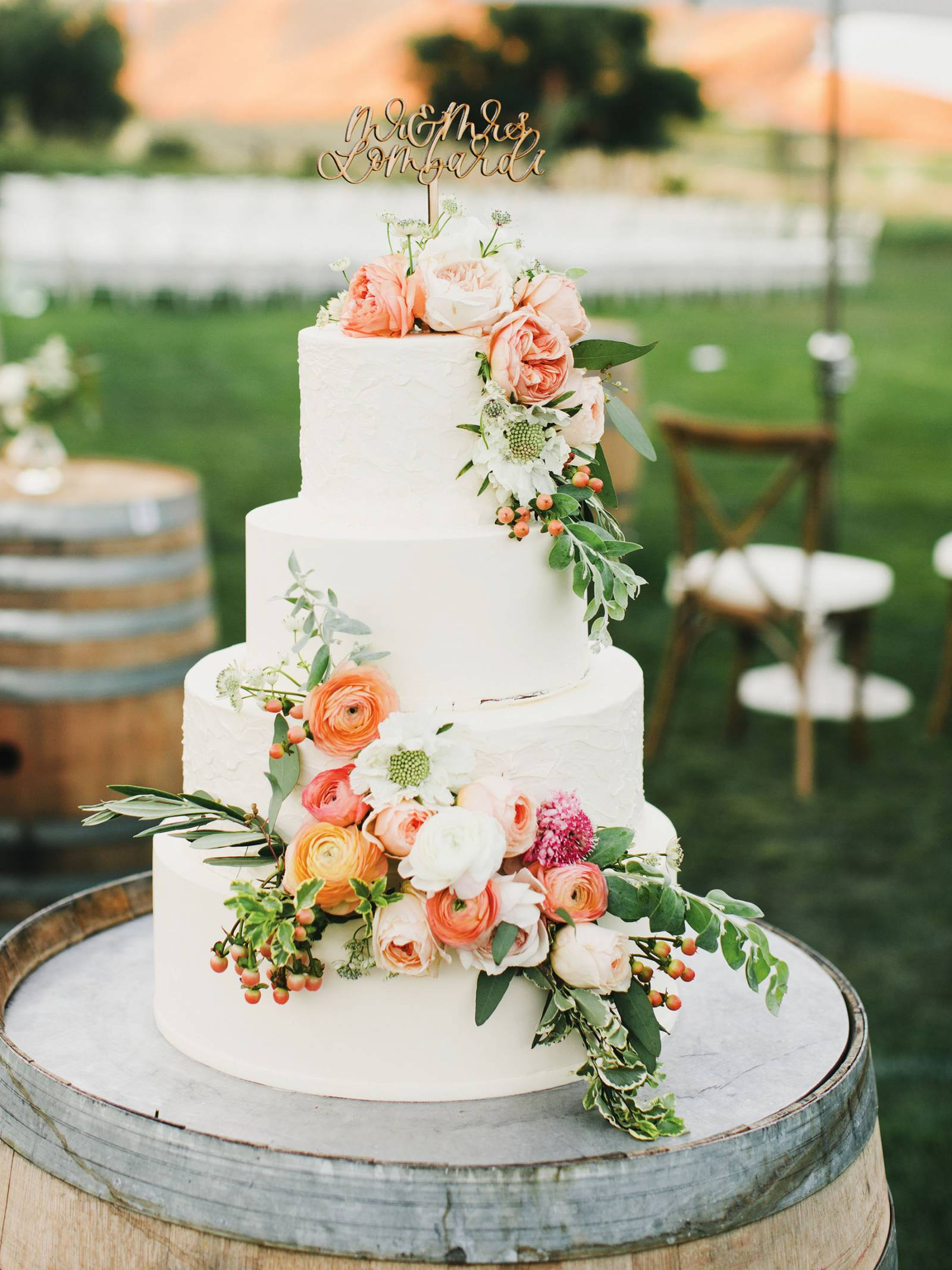 white cake with coral and blush flowers