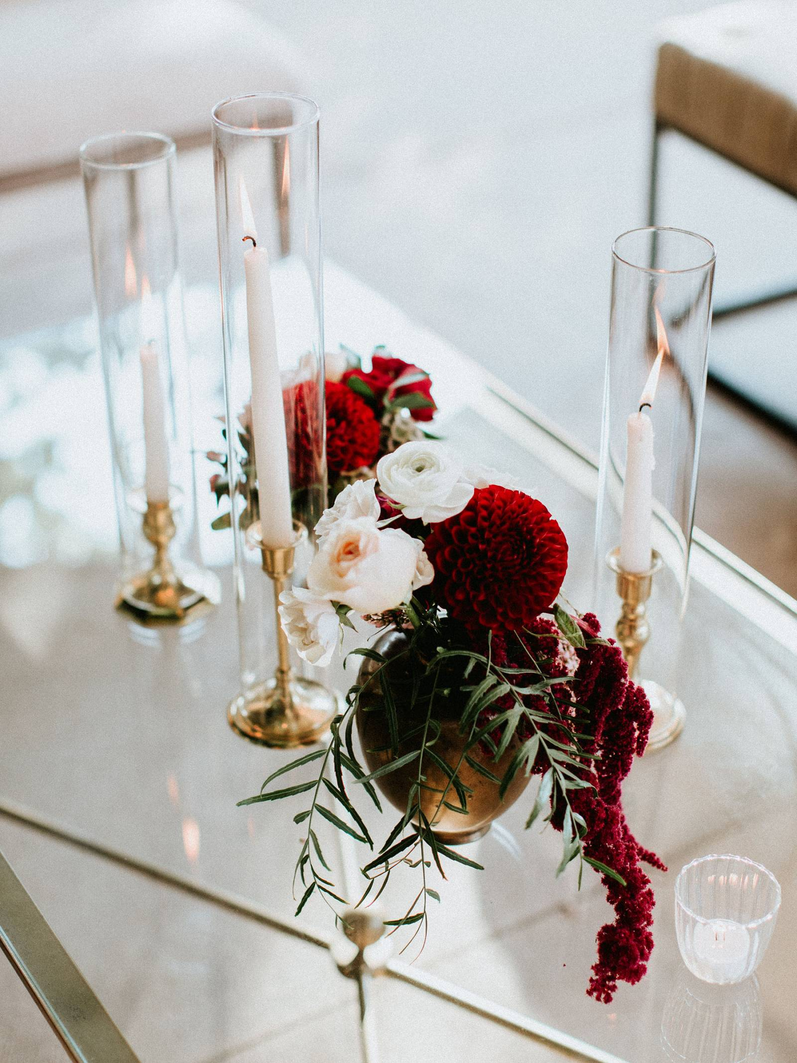 burgundy and blush florals with taper candles