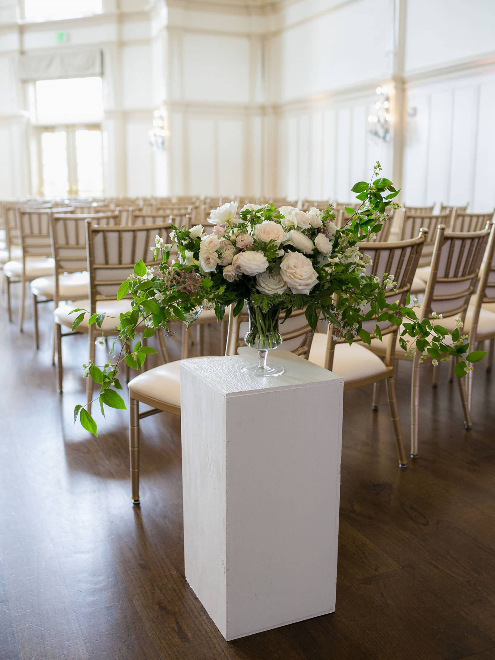 ceremony aisle floral arrangement in white and blush with greenery