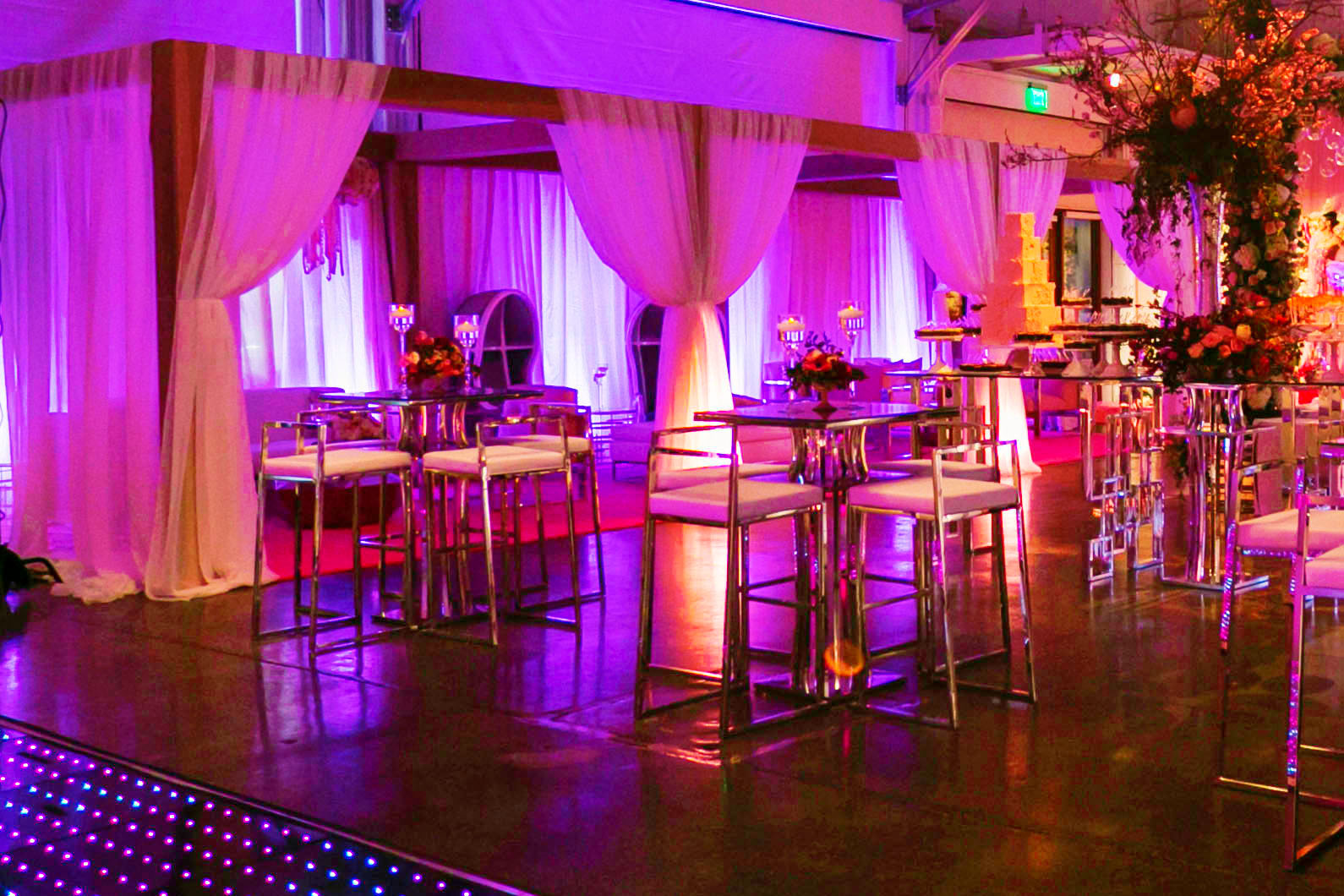 Draped cabanas with violet lighting