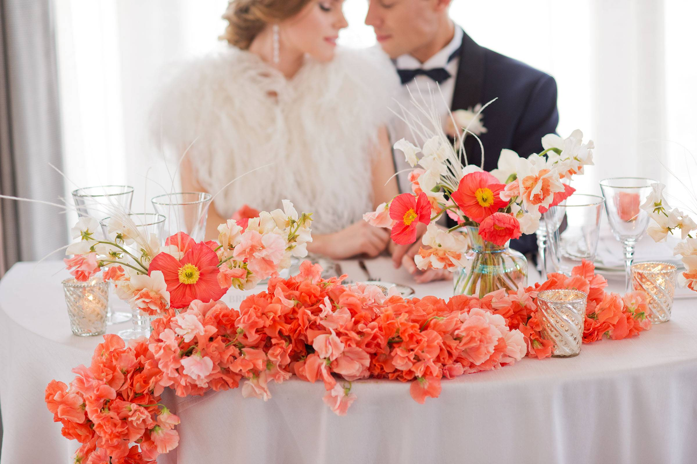 Living coral floral table runner of sweet pea blooms and poppies