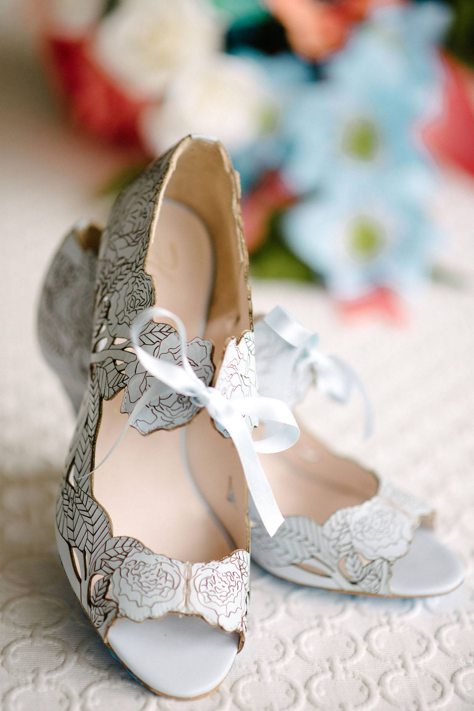 Powder blue heels with etched floral design in gold
