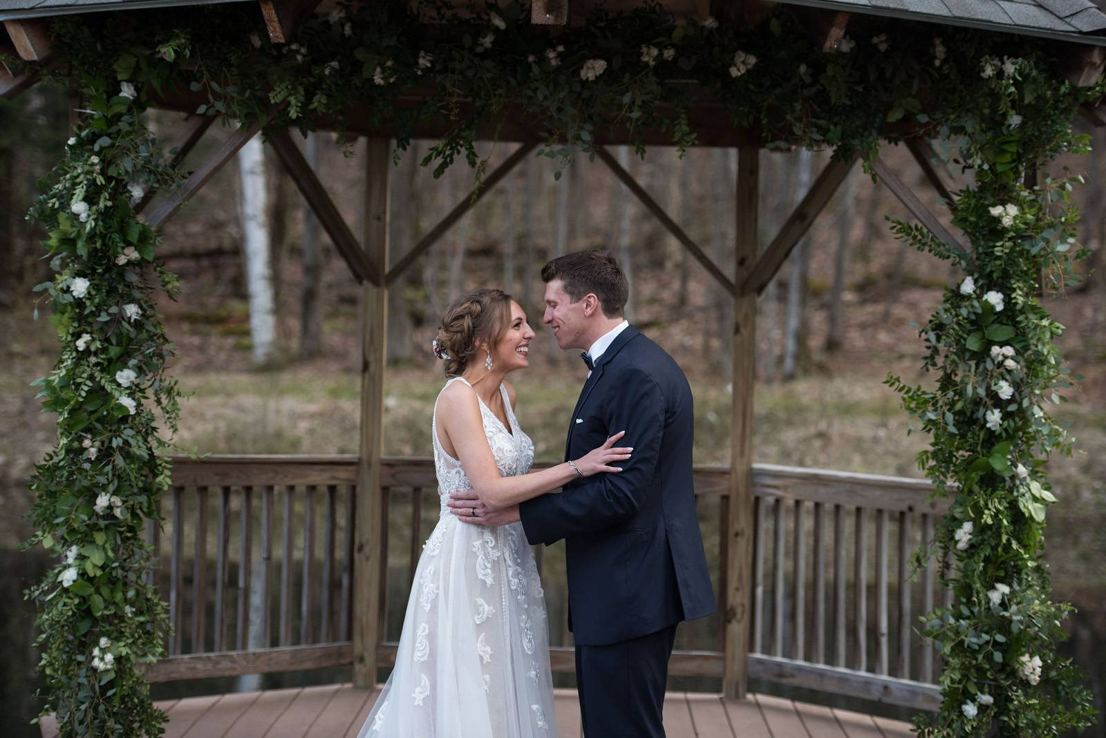 Bride and groom after their ceremony under gazebo at Sleepy Hollow during spring Vermont wedding