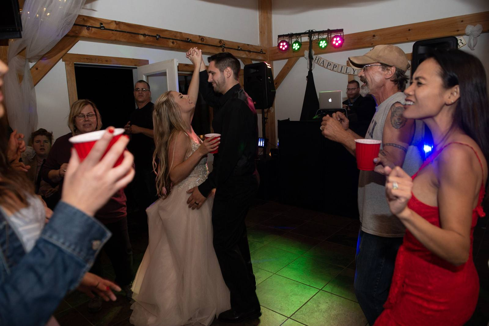 Dancing at indoor reception at Sharp Farm Milton Vermont wedding venue
