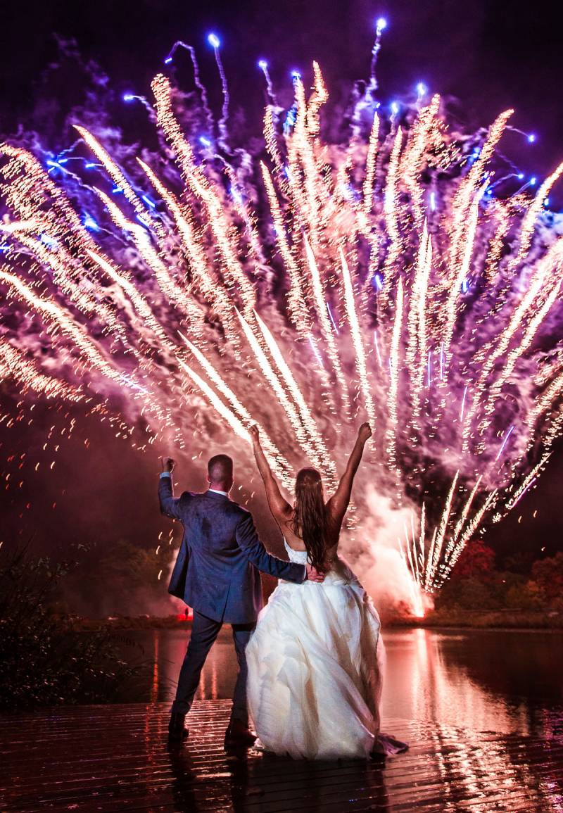 Bride and groom watching a firework display on their wedding day
