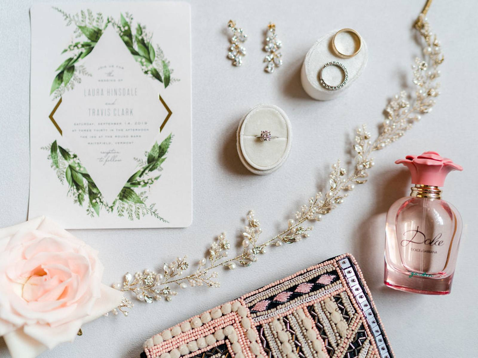 Elegant wedding details including invitation and bridal jewelry