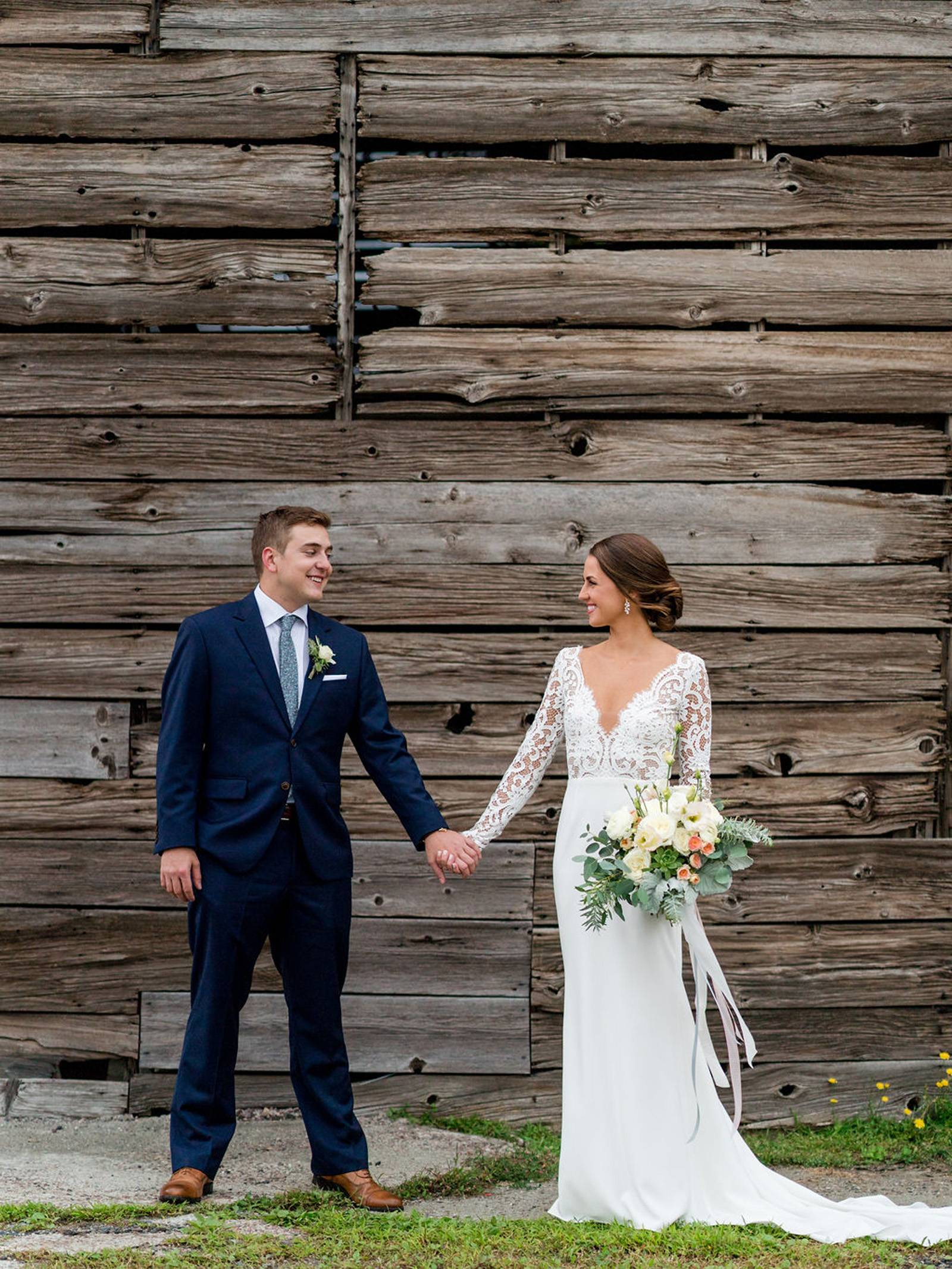 Bride and groom wedding day portrait at the Inn at the Round Barn Farm rustic backdrop photo