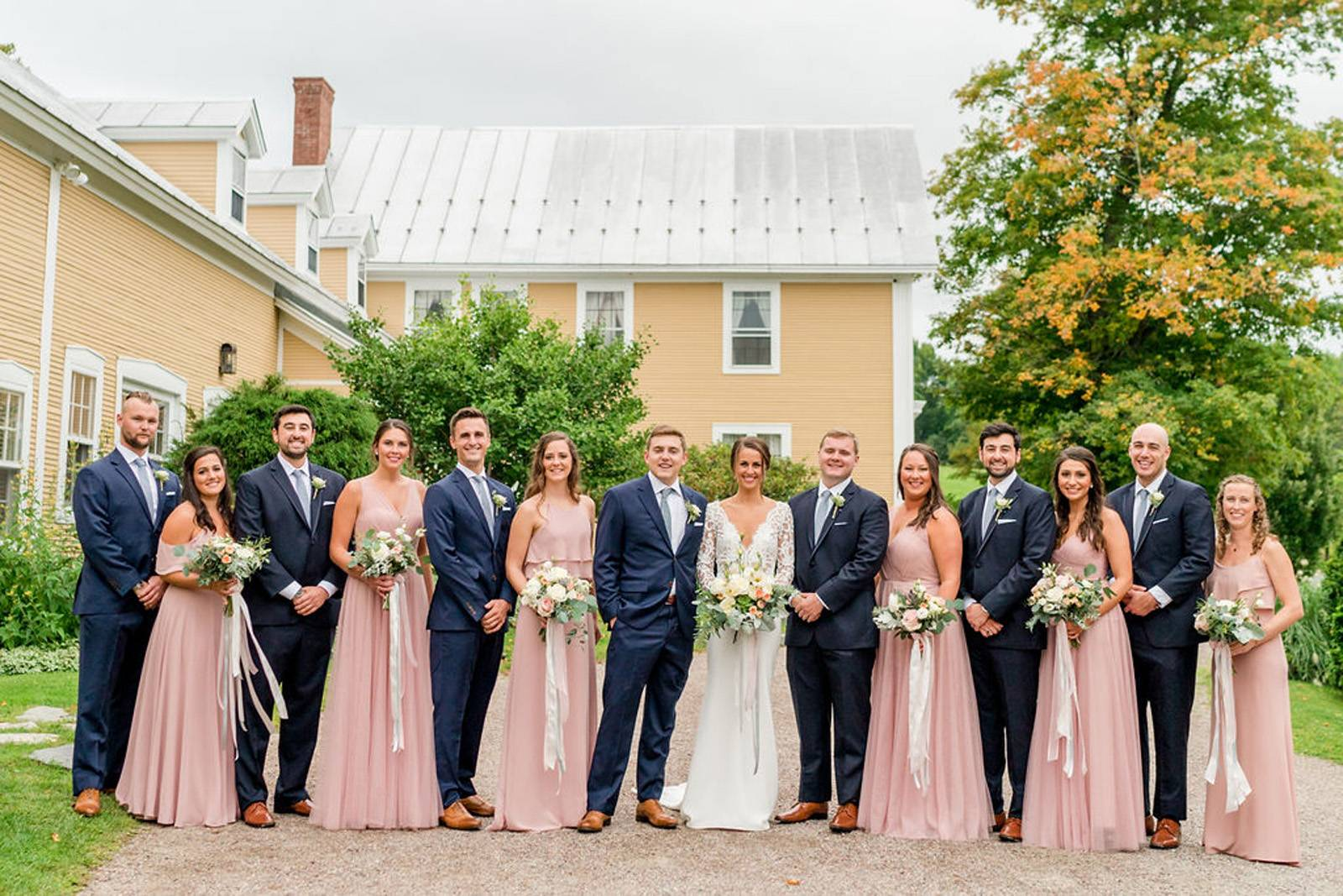 Groomsmen in navy and bridesmaids in blush on wedding day at the Inn at the Round Barn Farm
