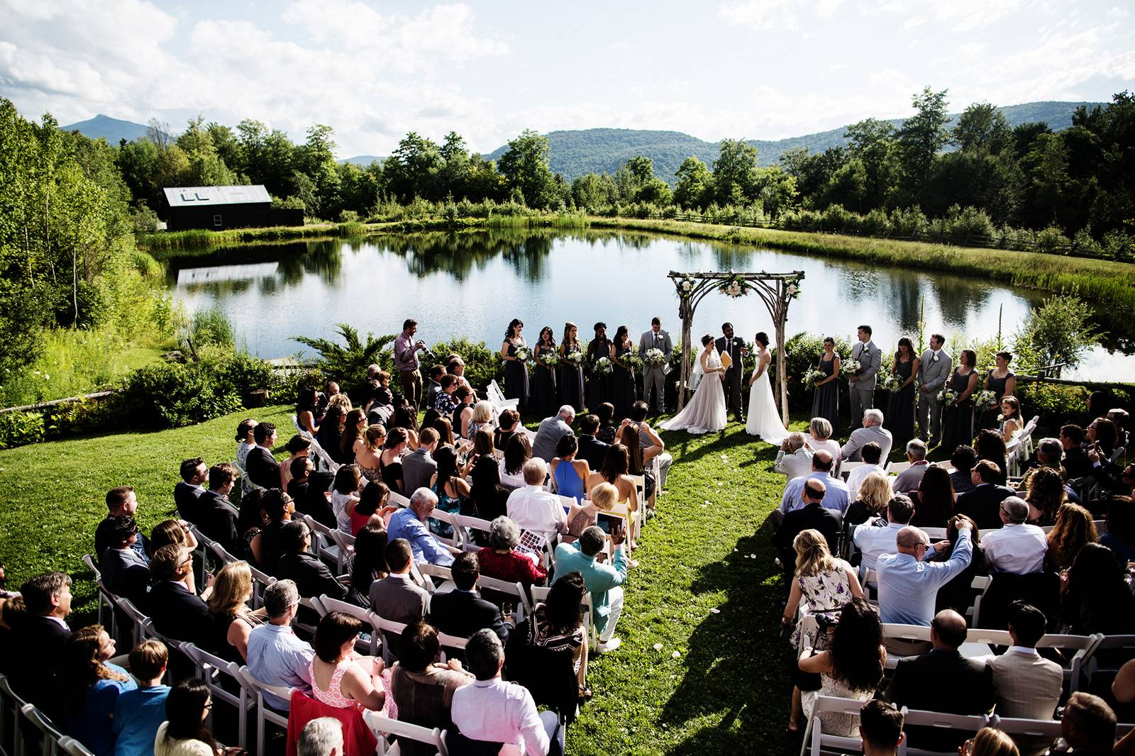 Two brides wedding ceremony at The Ponds at Bolton Valley for summer Vermont Wedding captured by Hap