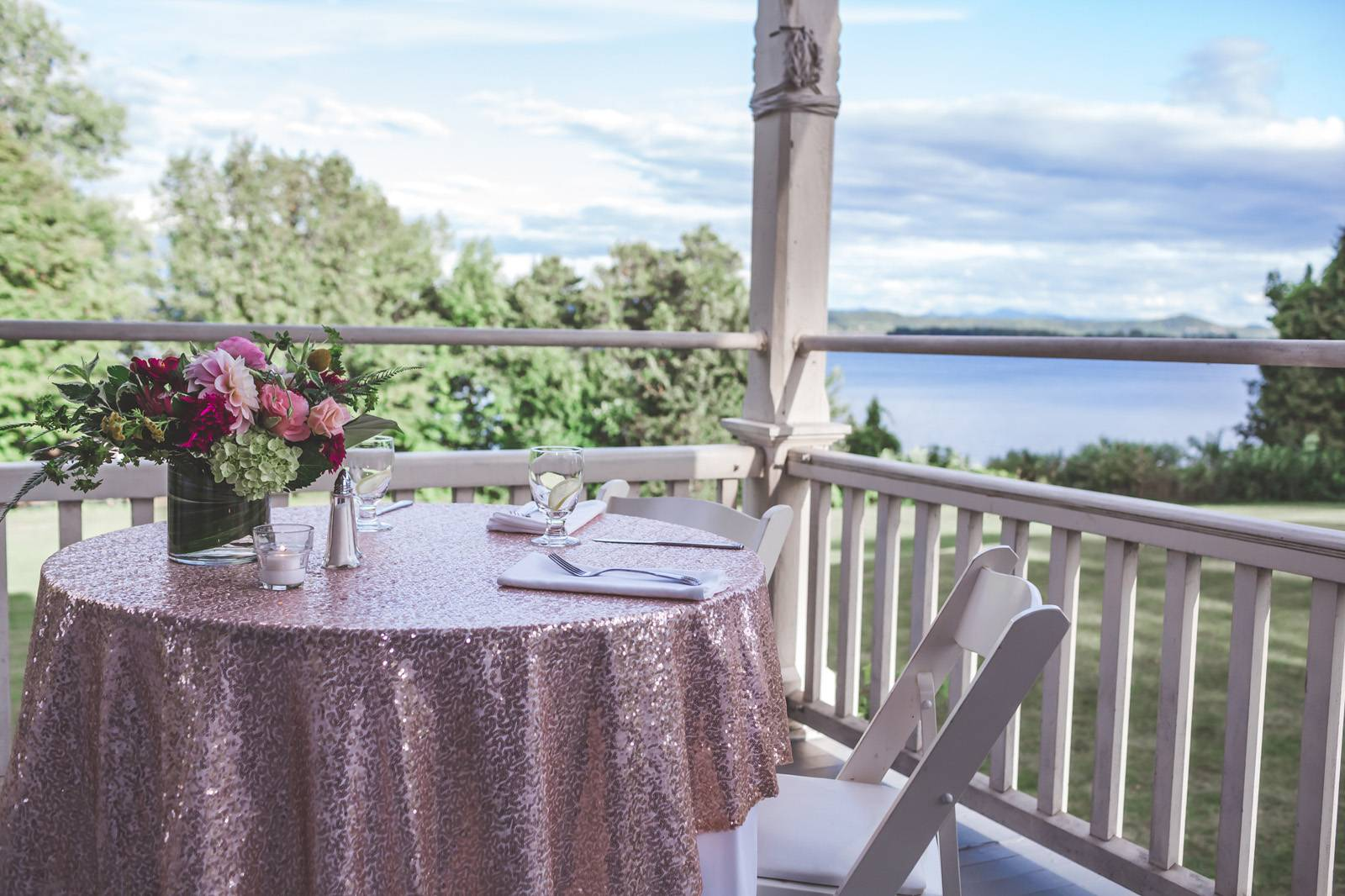 Sweetheart table with pink sequins table cloth and view of Lake Champlain at the Grand Isle Lake Hou