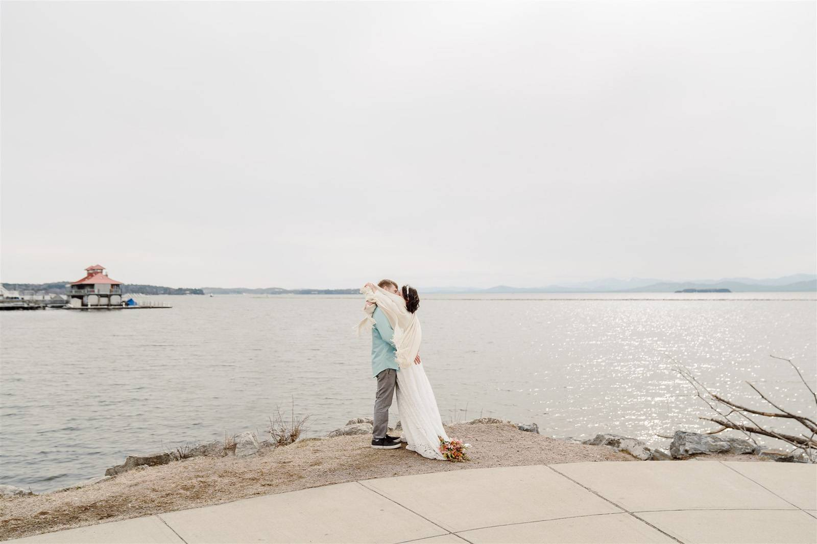 Couple kissing after lakefront Burlington elopement in March