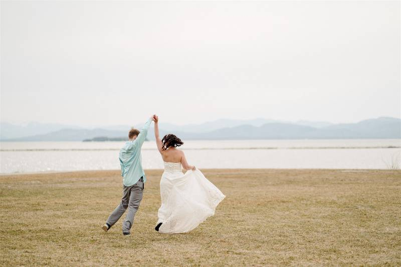 Bride and groom dancing the lawn in Burlington Waterfront park after lakeside elopement ceremony in
