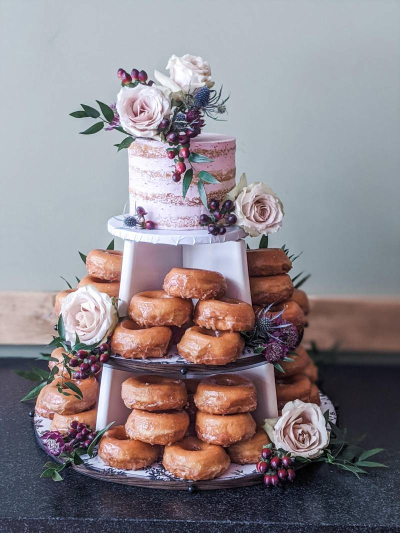 Donut and small wedding cake tower with floral accents