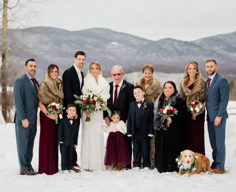 Dog wearing a floral collar at winter wedding in Vermont