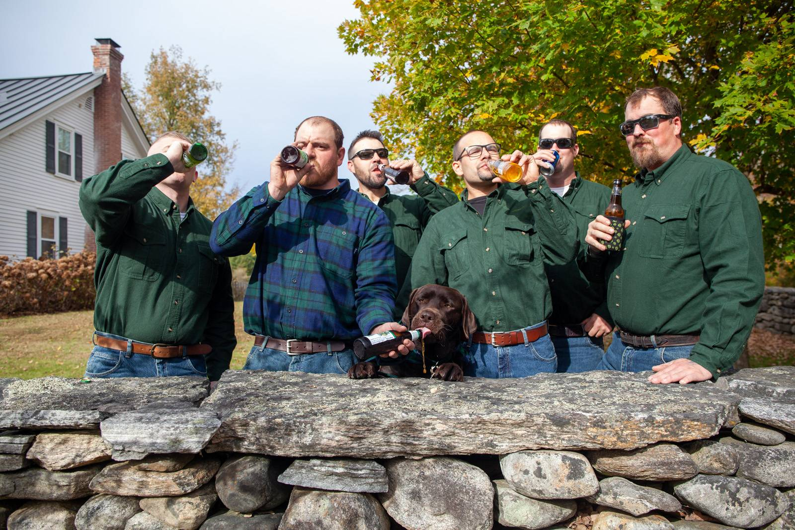Groomsmen share a beer with groom's dog on wedding day