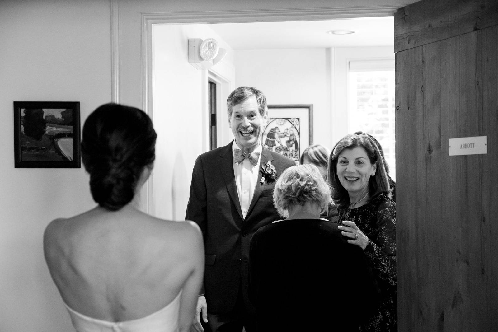 First look with father of the bride smiling at bride