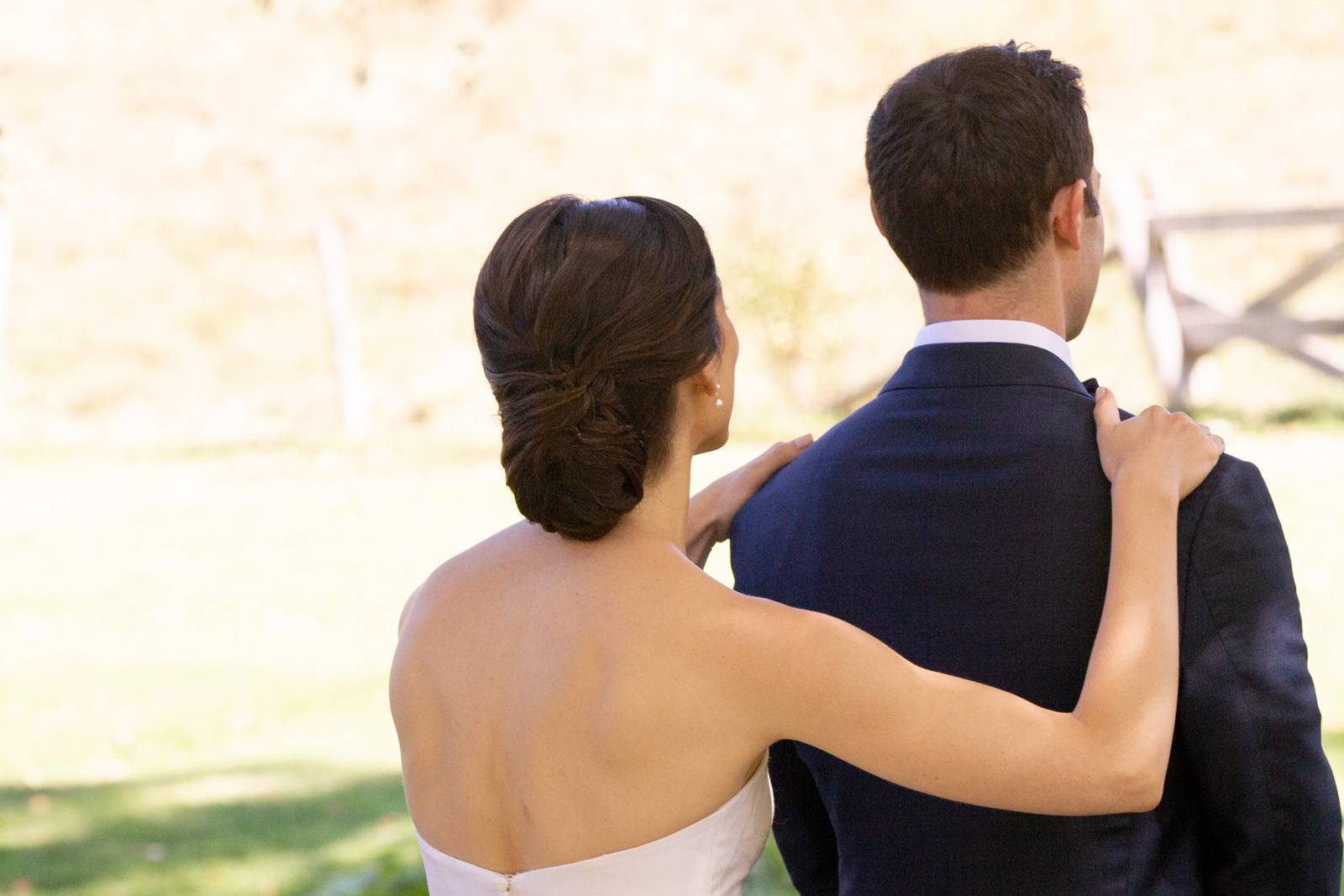 Classic chignon updo and strapless wedding gown for romantic fall wedding
