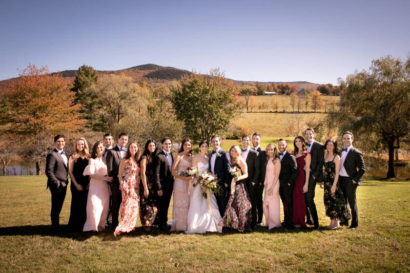 Fall wedding party with mismatched bridesmaid dresses in burgundy and blush tones for fall Vermont w